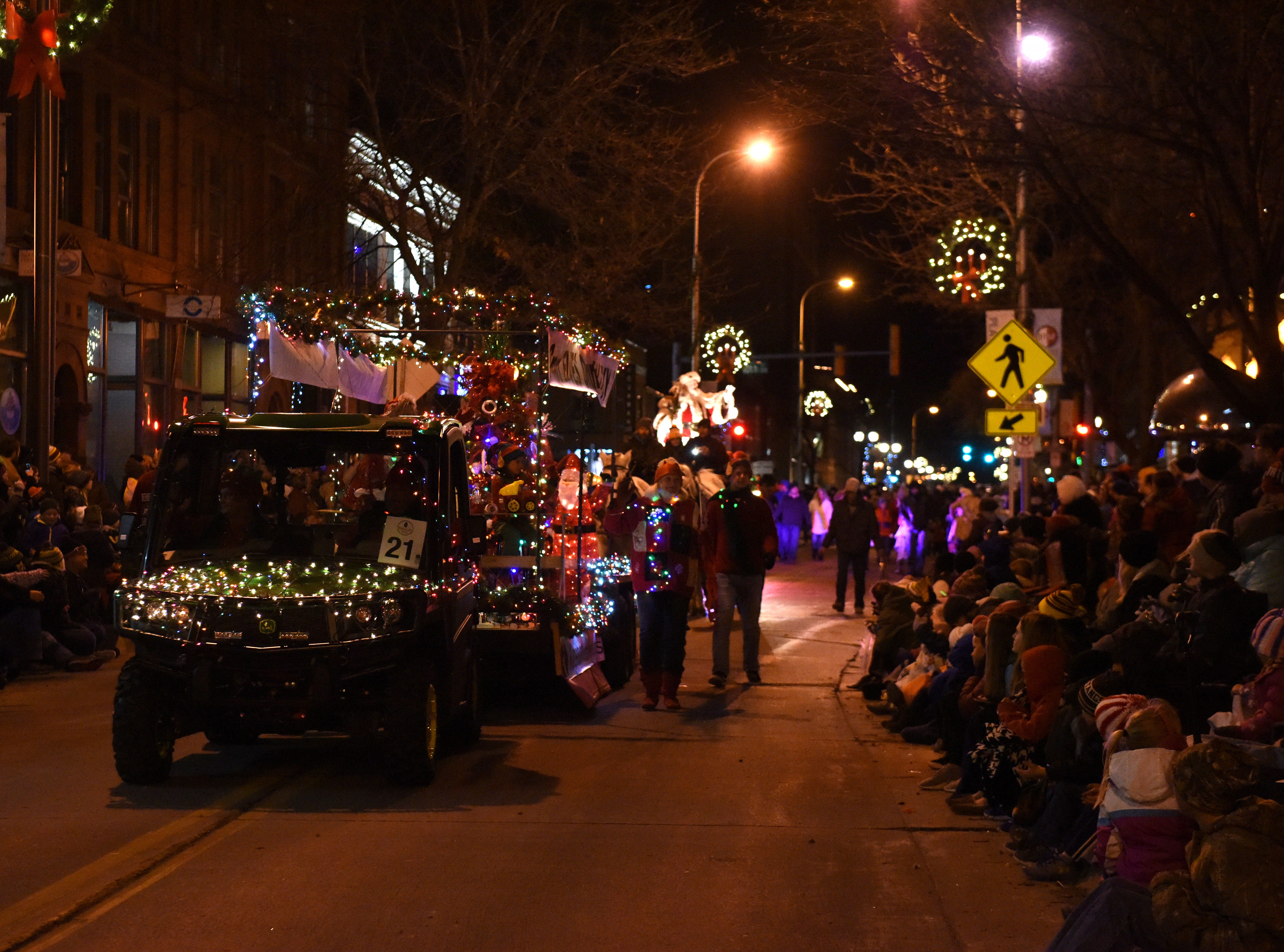 People gather to watch the annual Parade of Lights in downtown Sioux Falls, S.D., Friday, Nov. 23, 2018.
