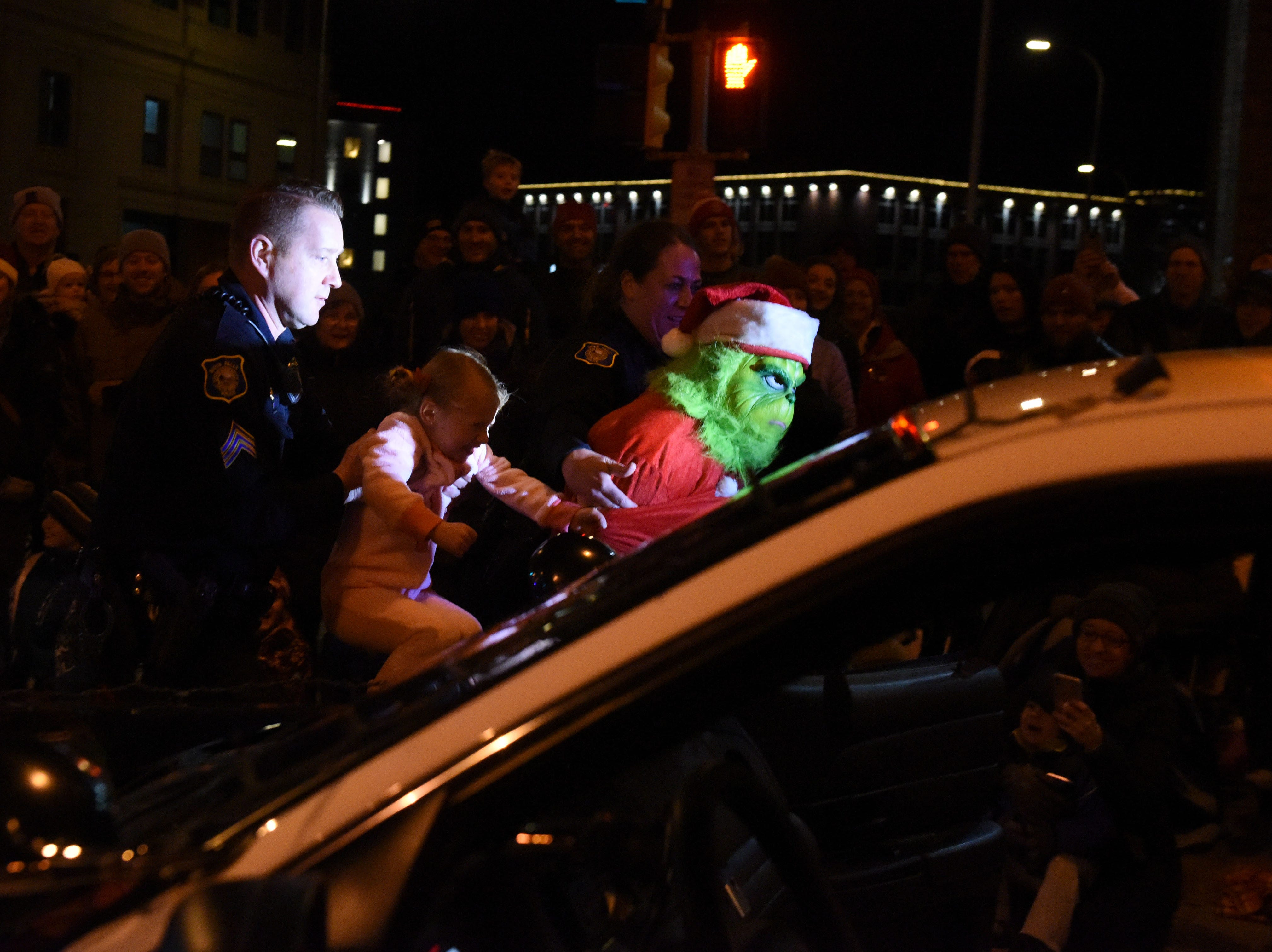 The Grinch made an appearance at the annual Parade of Lights in downtown Sioux Falls, S.D., Friday, Nov. 23, 2018.
