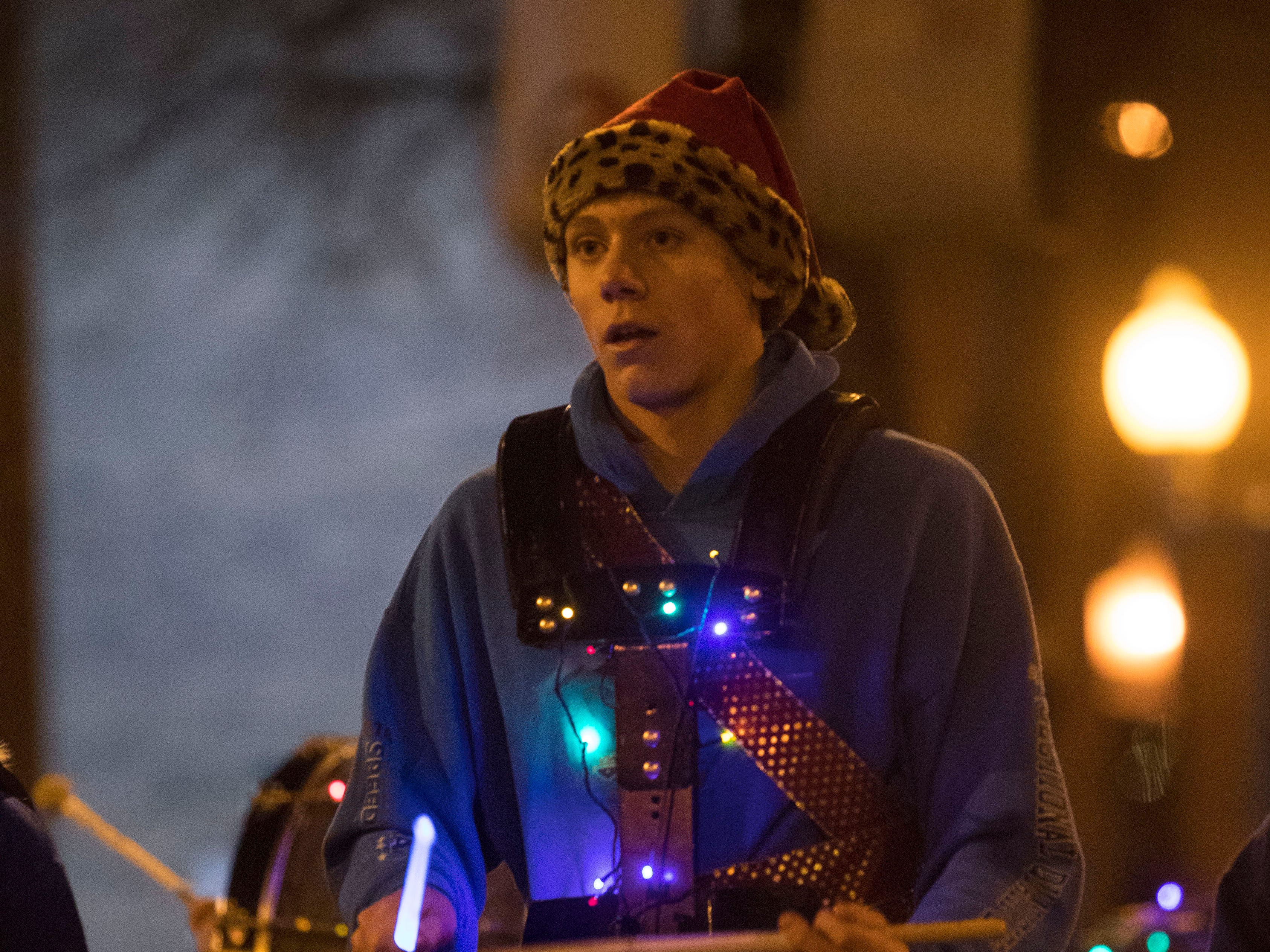 Band member participates in the annual Parade of Lights in downtown Sioux Falls, S.D., Friday, Nov. 23, 2018.