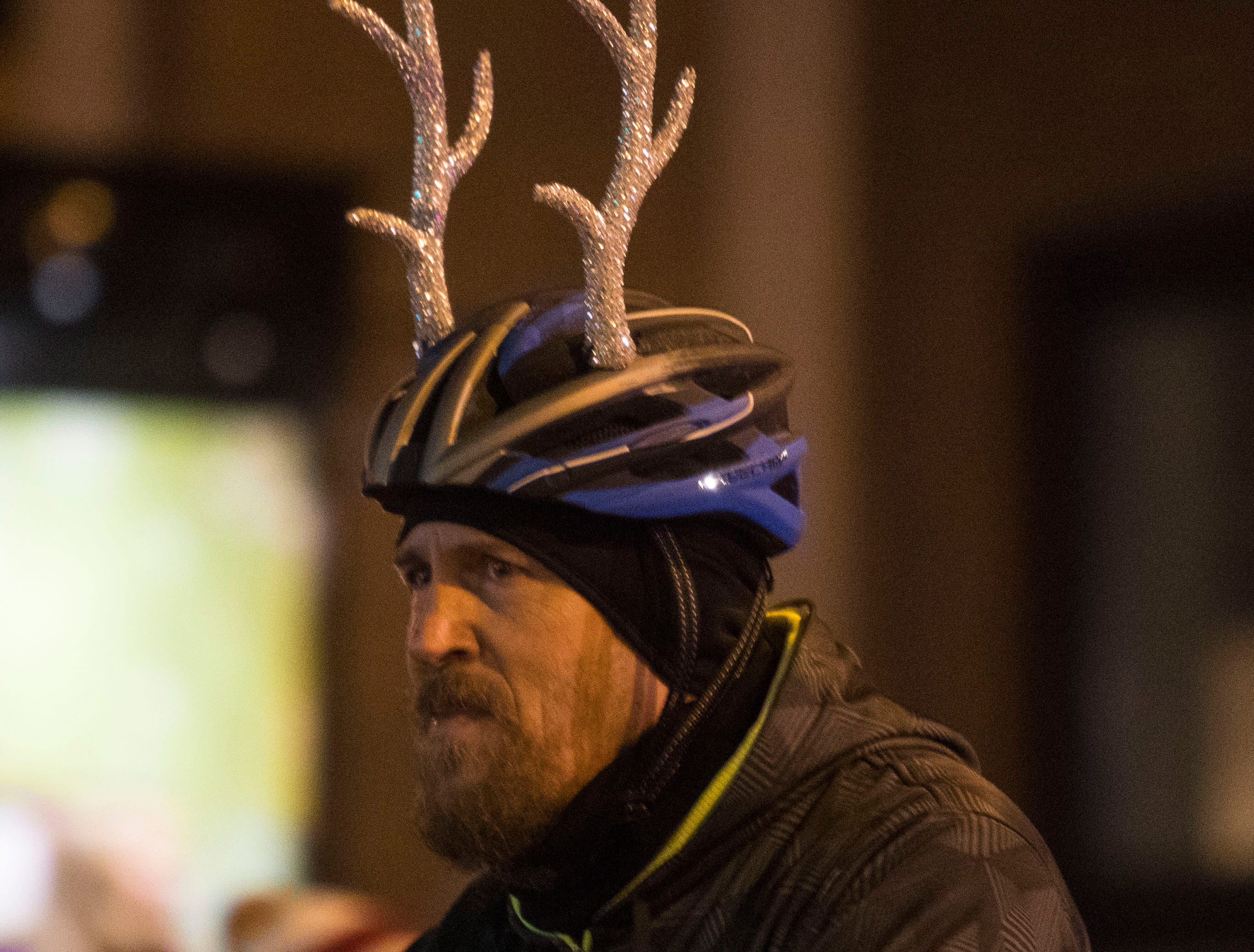 Cyclist participates in the annual Parade of Lights in downtown Sioux Falls, S.D., Friday, Nov. 23, 2018.