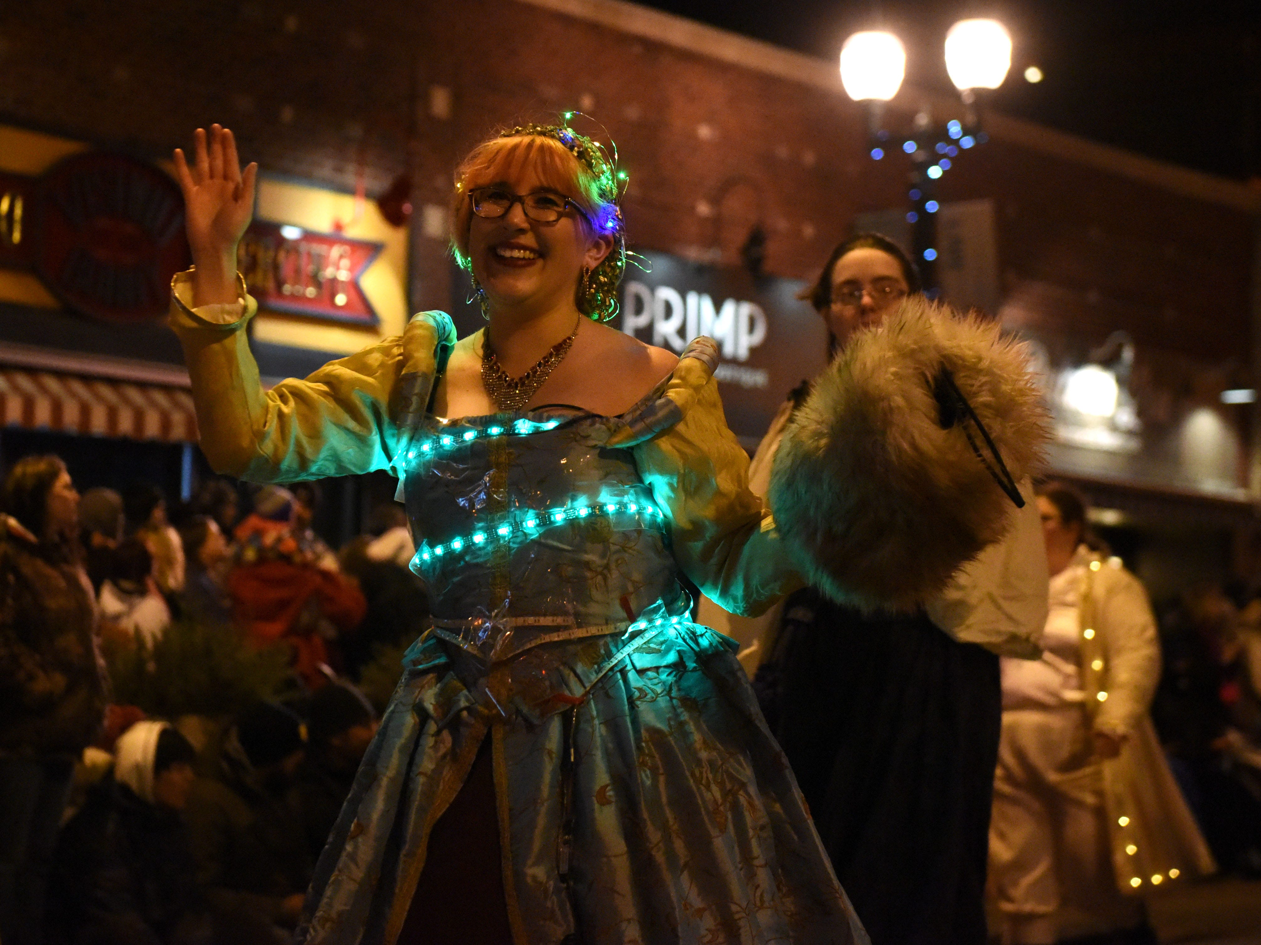 People participate in the annual Parade of Lights in downtown Sioux Falls, S.D., Friday, Nov. 23, 2018.