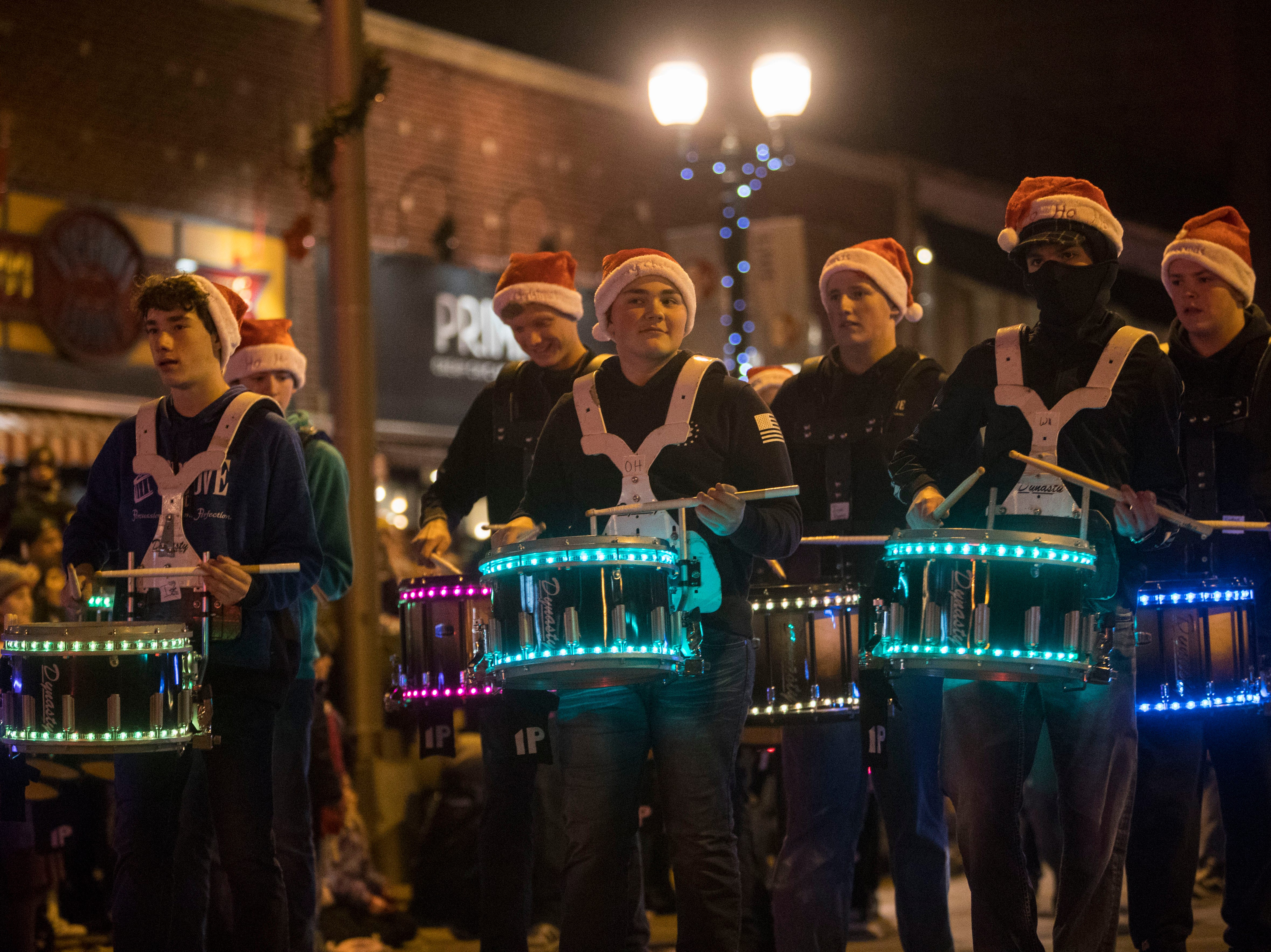 High school band participates in the annual Parade of Lights in downtown Sioux Falls, S.D., Friday, Nov. 23, 2018.