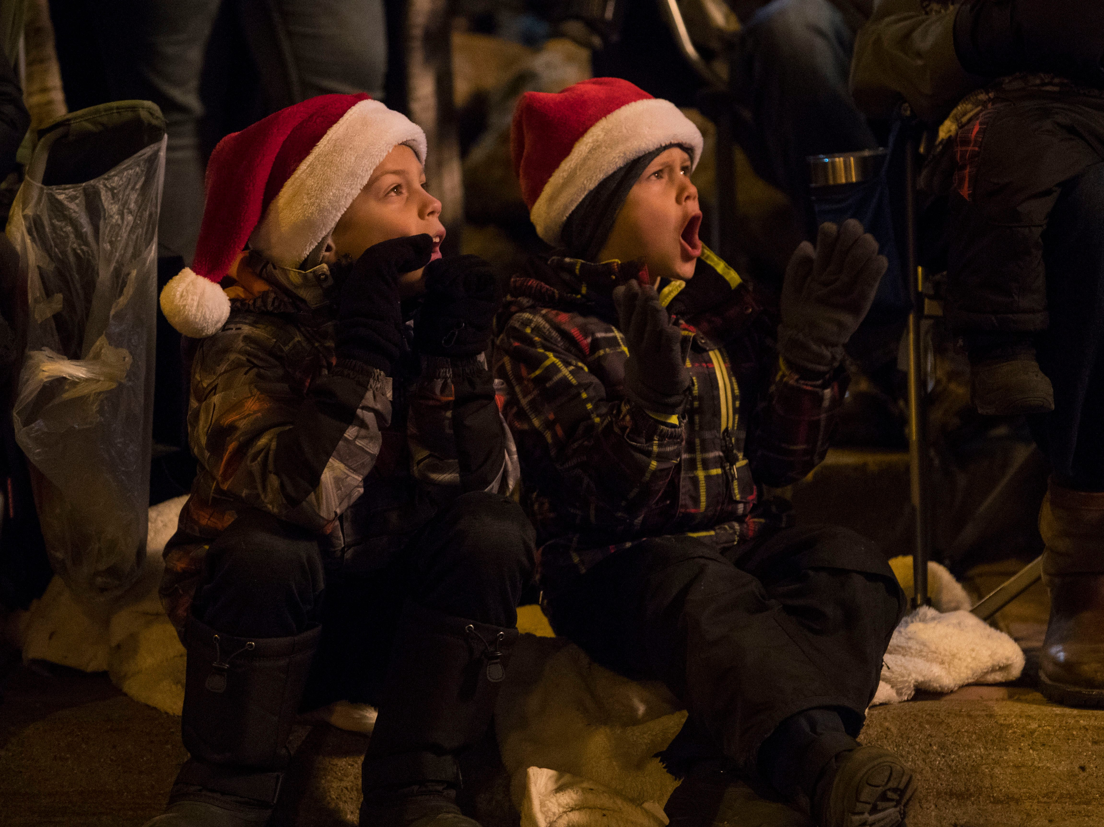 Kids react during the annual Parade of Lights in downtown Sioux Falls, S.D., Friday, Nov. 23, 2018.