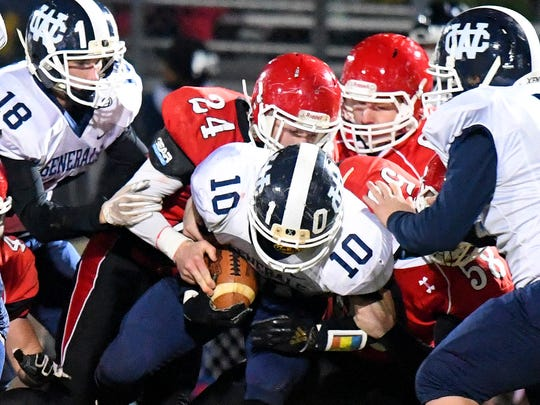 Riverheads' Jaden Phillips and Davis Cogar work together to tackle William Campbell ball carrier Jordan Young during the Region 1B championship, played in Greenville on Friday, Nov. 23, 2018.