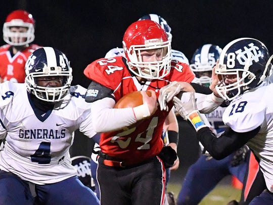 Riverheads' Jaden Phillips has the ball as he is caught between William Campbell's Zekeya Townes and Jonathan Hicks during the Region 1B championship, played in Greenville on Friday, Nov. 23, 2018.