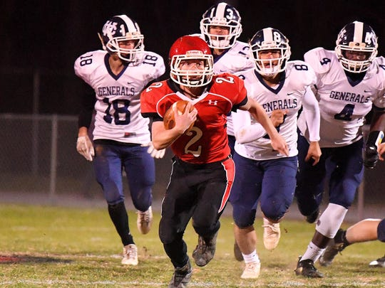 Riverheads' Devin Morris breaks through with the football and keeps going during the Region 1B championship, played in Greenville on Friday, Nov. 23, 2018.