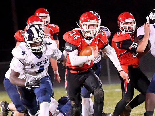 Riverheads' Jaden Phillips takes off with the football after breaking through the William Campbell defensive line during the Region 1B championship, played in Greenville on Friday, Nov. 23, 2018.