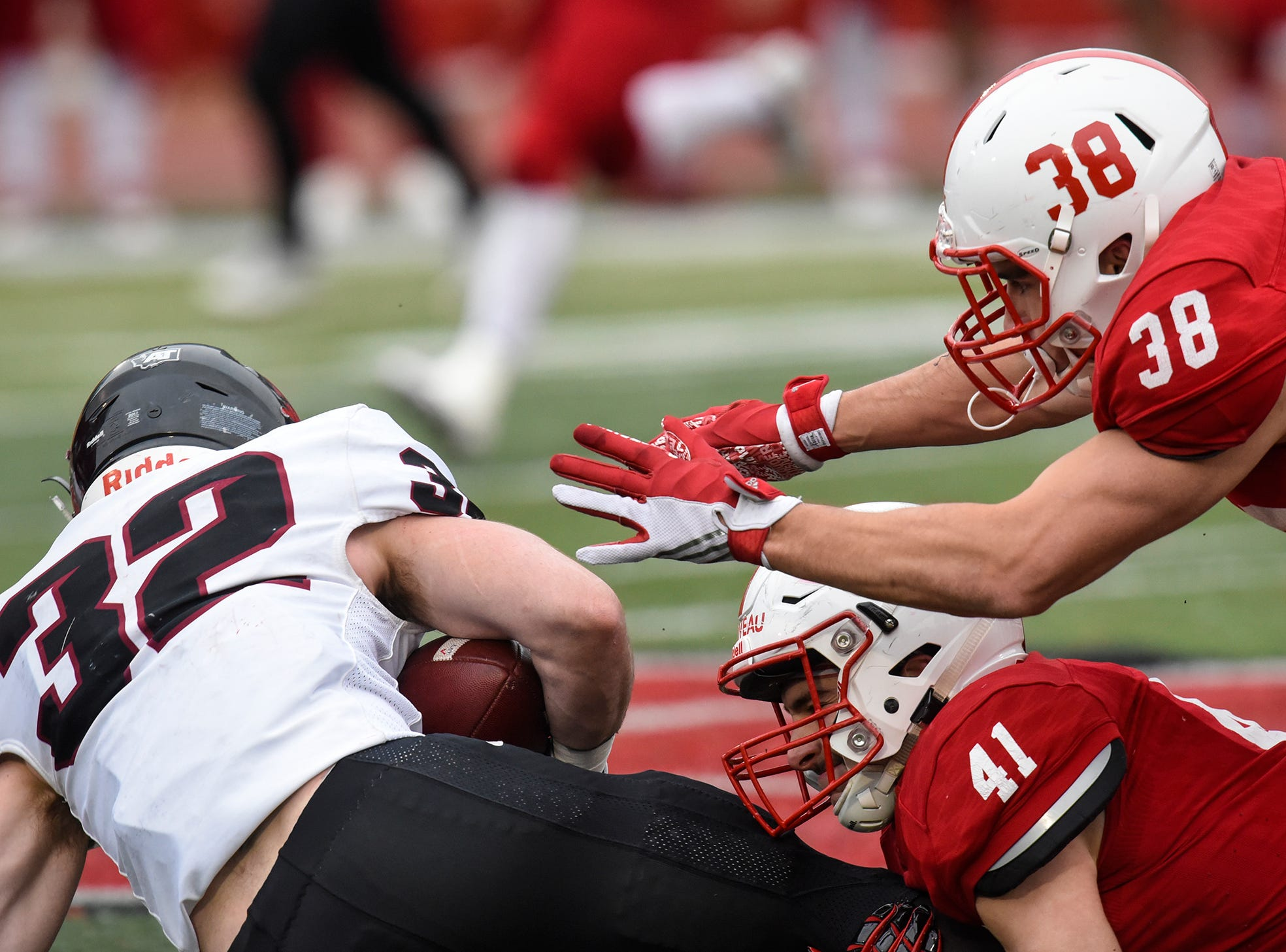 Alex Sais and Richard Carriveau of St. John's team up on a tackle during the Saturday, Nov. 24, game against Whitworth at Clemens Stadium in Collegeville.