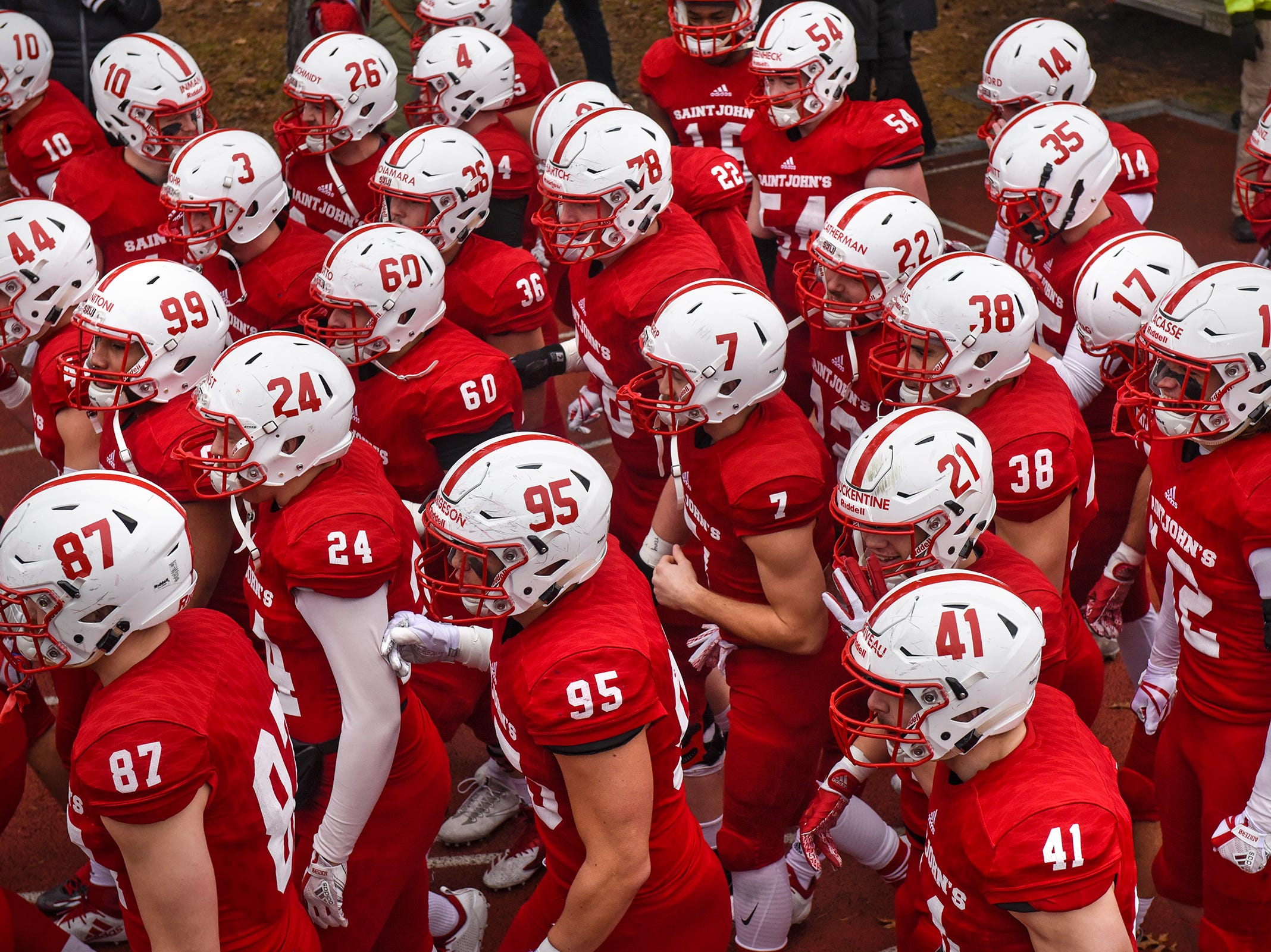 St. John's players prepare to take the field for the Saturday, Nov. 24, game against Whitworth at Clemens Stadium in Collegeville.