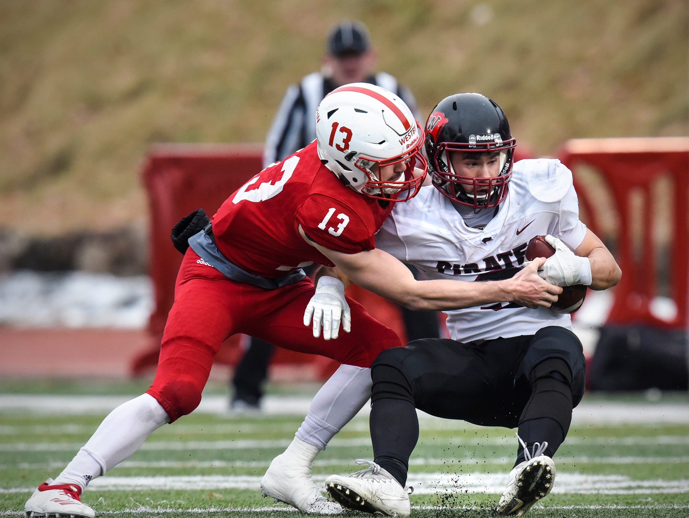 Sam Westby of St. John's tackles Garrett McKay of Whitworth during the Saturday, Nov. 24, game  at Clemens Stadium in Collegeville.