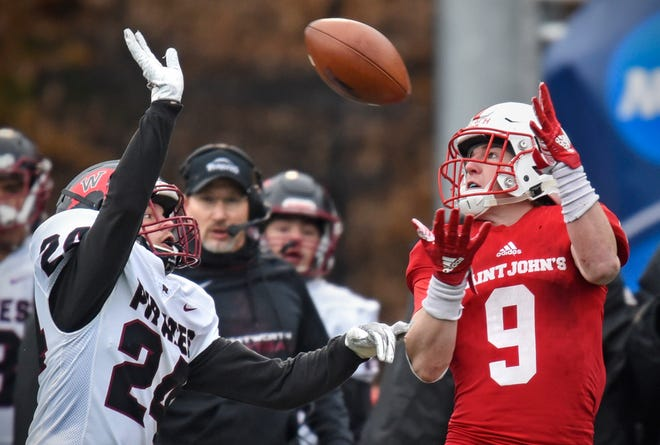 Zach Hillman of Whitworth tries to break up a pass to Will Gillach of St. John'sduring the Saturday, Nov. 24, game at Clemens Stadium in Collegeville. St. John's won 45-24 and will advance to the next round in the playoffs.
