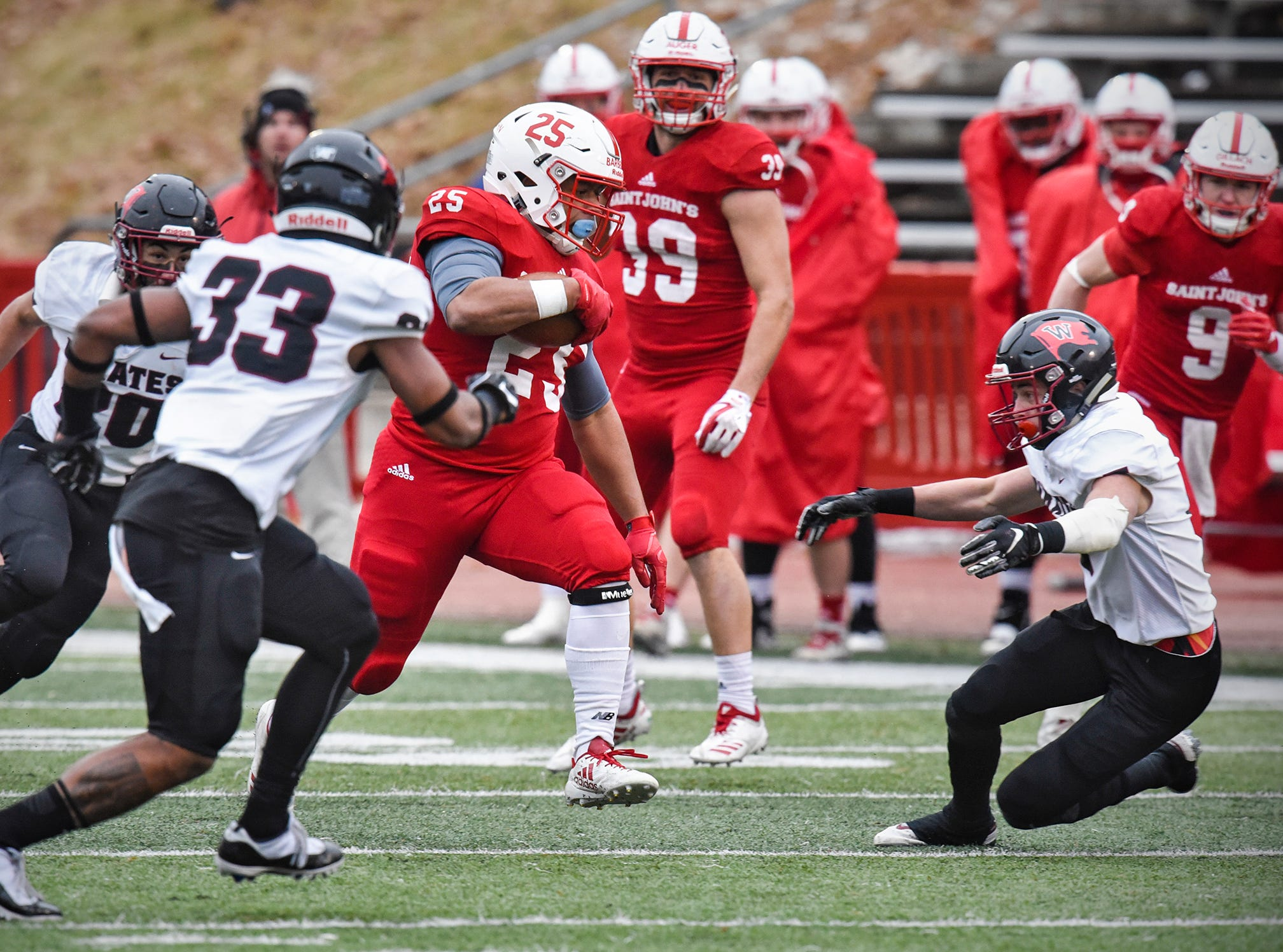 Kai Barber of St. John's rushes for a gain during the Saturday, Nov. 24, game against Whitworth at Clemens Stadium in Collegeville.