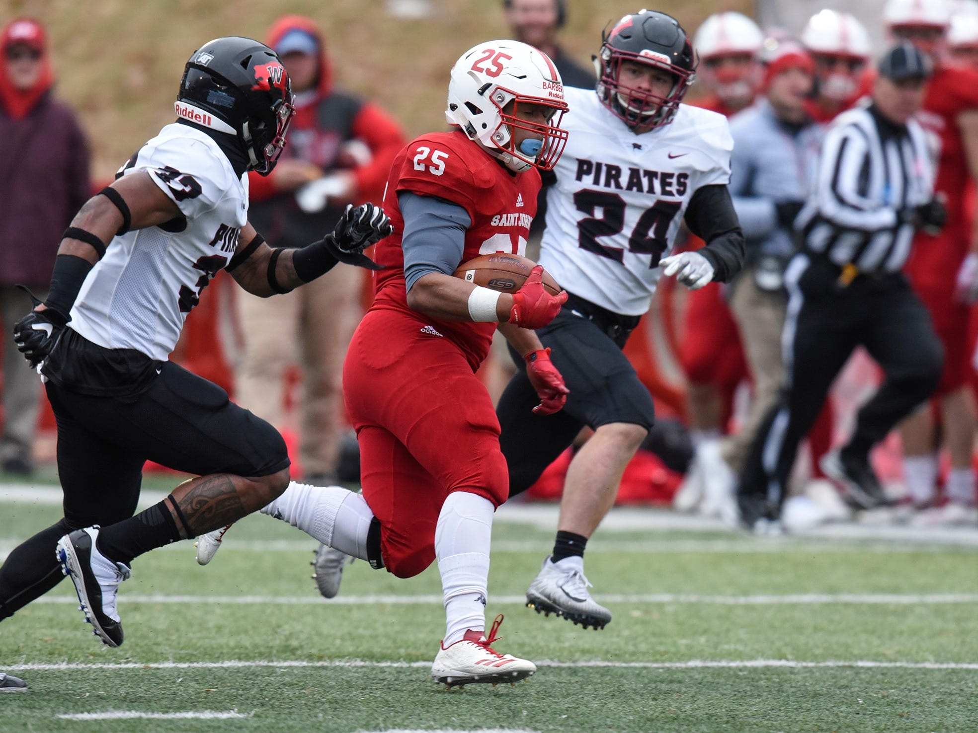 Kai Barber of St. John's rushes with the ball during the Saturday, Nov. 24, game against Whitworth at Clemens Stadium in Collegeville.