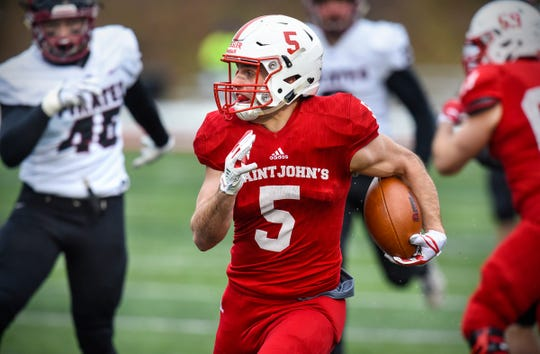Addam Essler of St. John's carries the ball during the Saturday, Nov. 24, game against Whitworth at Clemens Stadium in Collegeville.