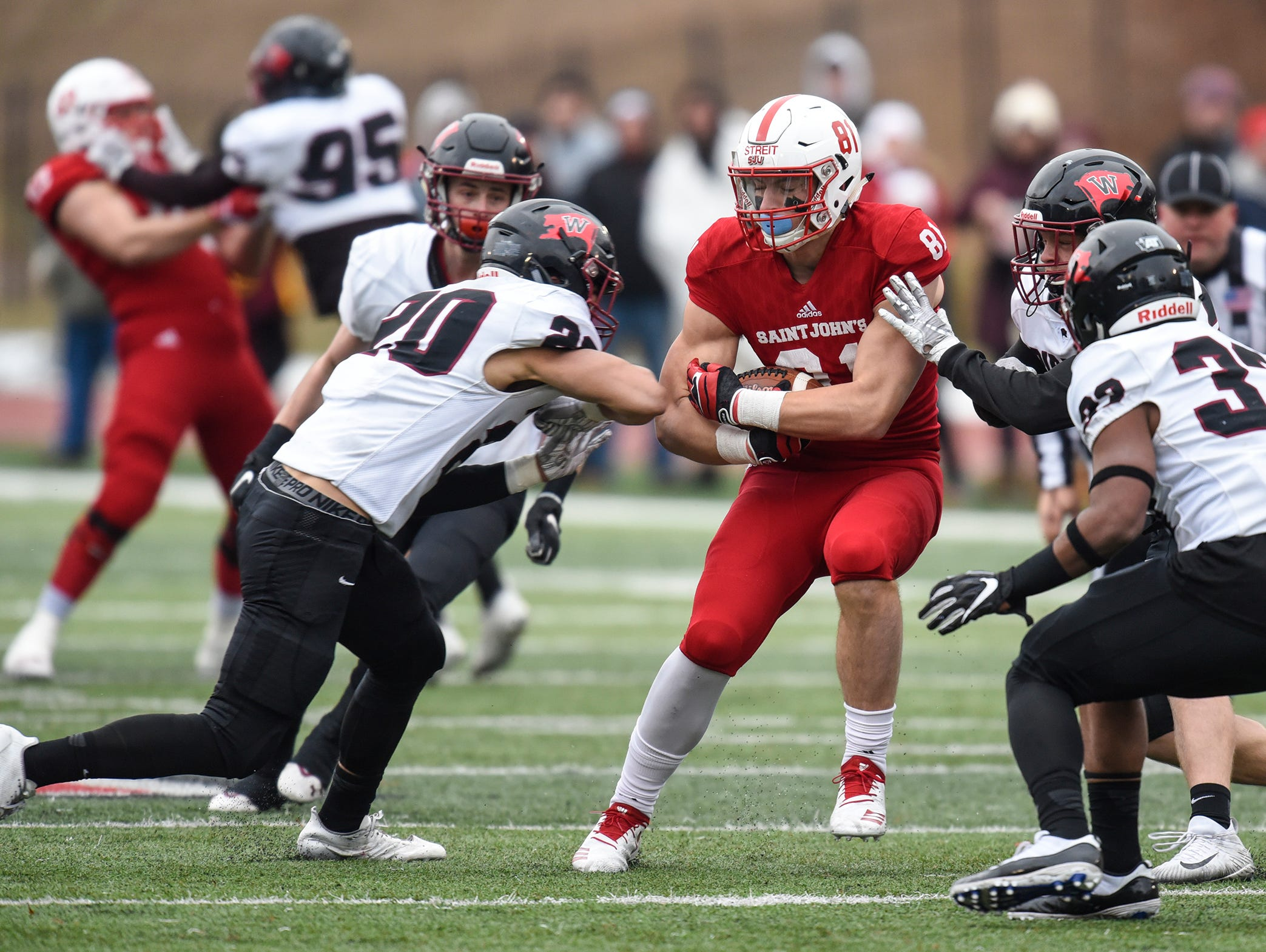 Jared Streit of St. John's rushes after catching a pass during the Saturday, Nov. 24, game against Whitworth at Clemens Stadium in Collegeville.