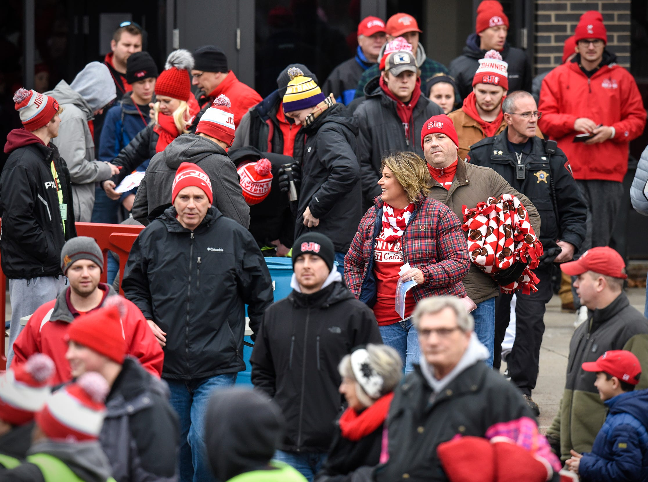 Fans enter the stadium for Saturday's playoff game against Whitworth at Clemens Stadium in Collegeville.