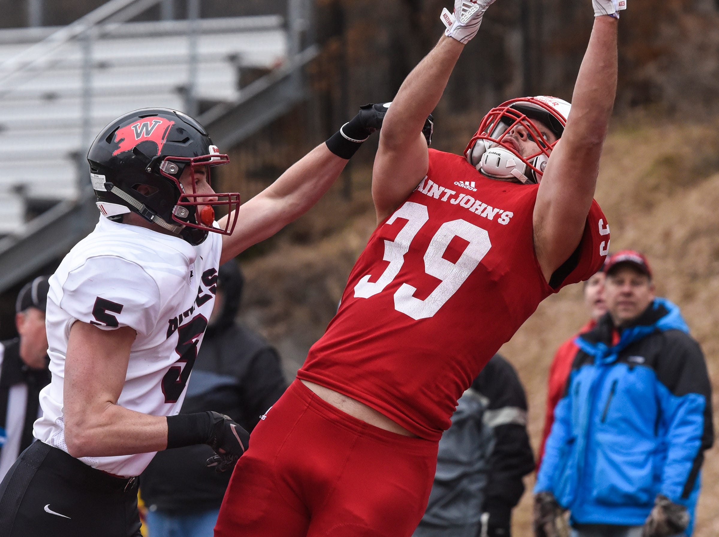 Tommy Auger of St. John's stretches to make a catch during the Saturday, Nov. 24, game against Whitworth at Clemens Stadium in Collegeville.