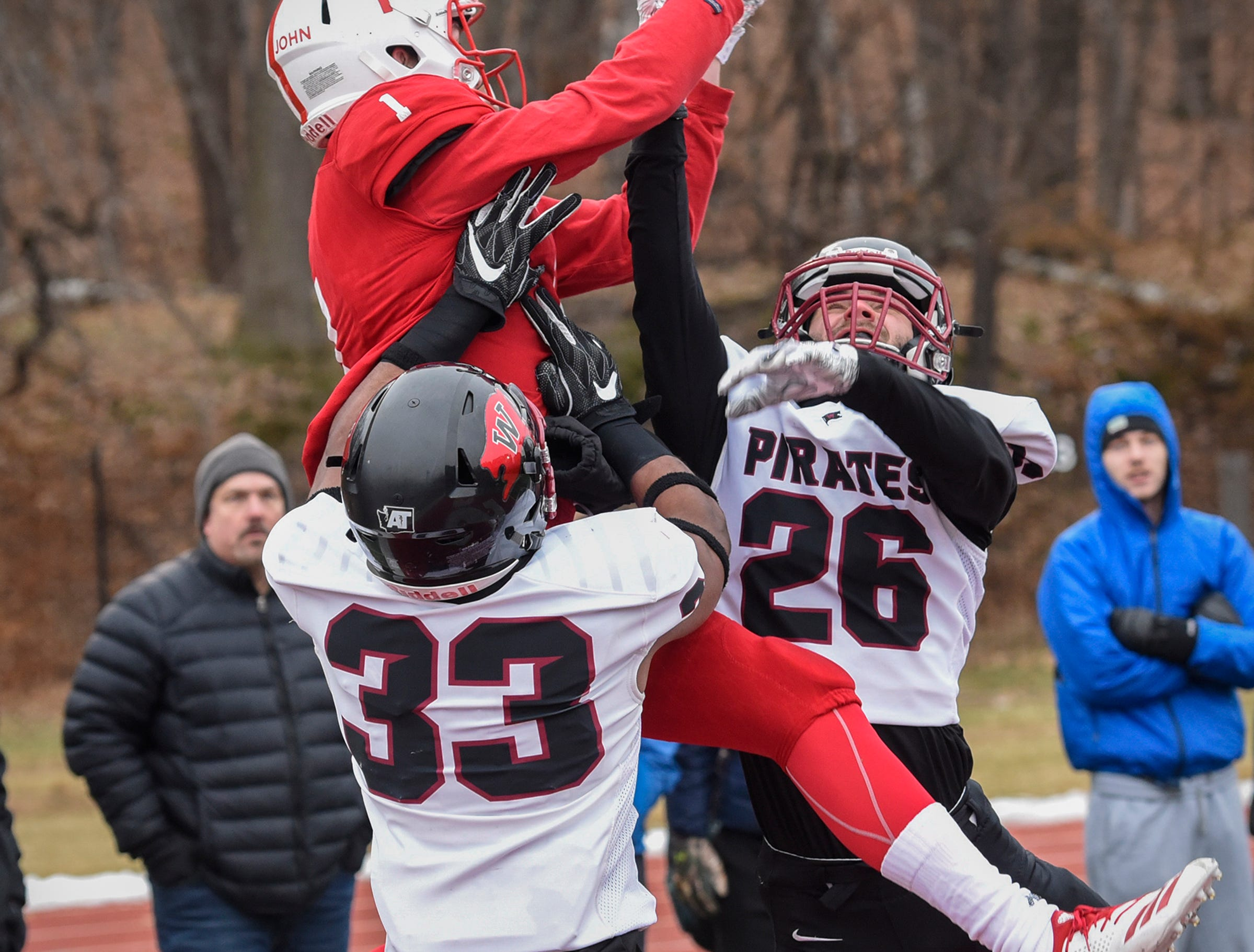 Joey Eckhoff of St. John's leaps to make a catch during the Saturday, Nov. 24, game against Whitworth at Clemens Stadium in Collegeville.