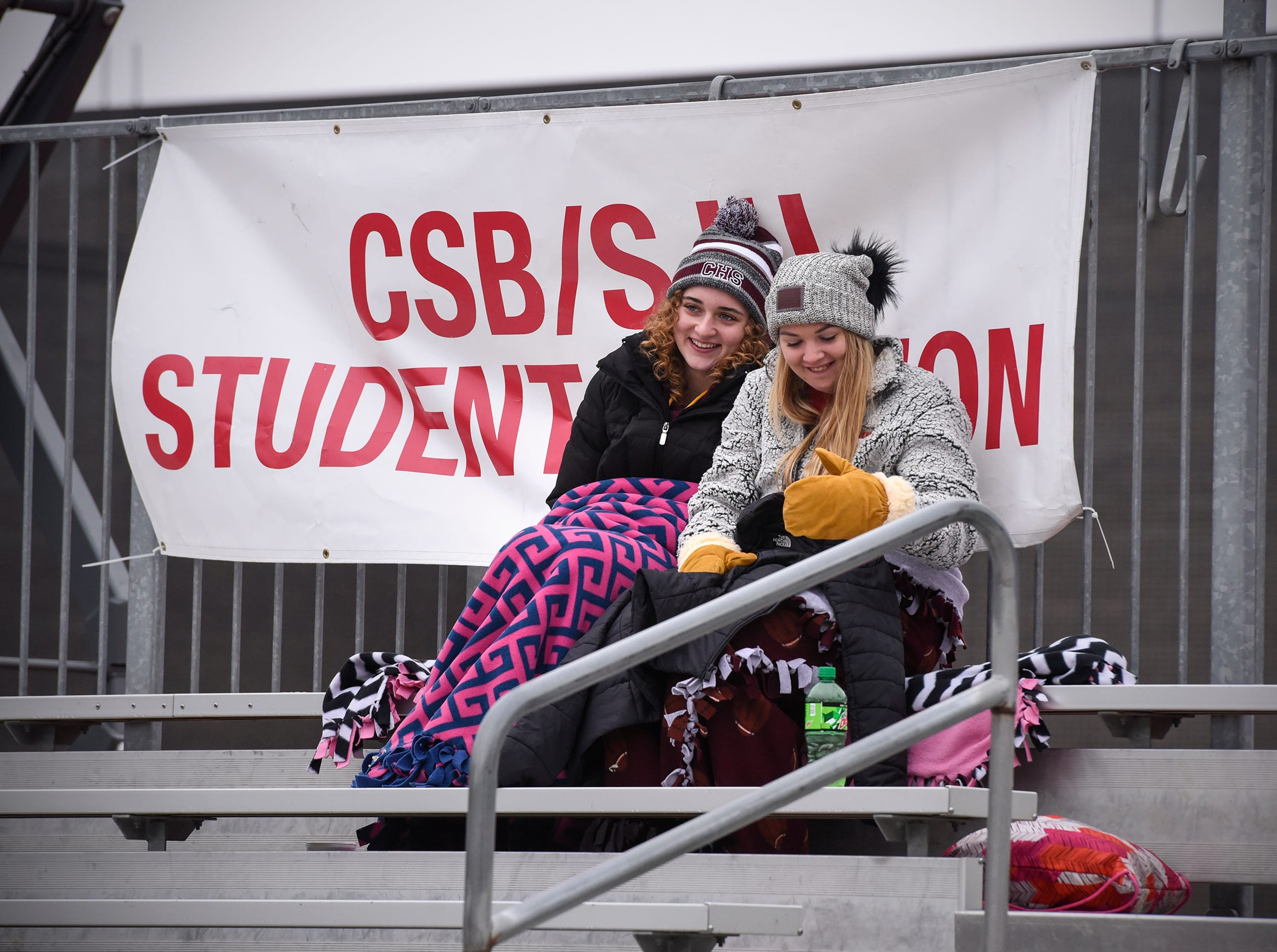 Fans stay warm in the student section during the Saturday, Nov. 24, game against Whitworth at Clemens Stadium in Collegeville.