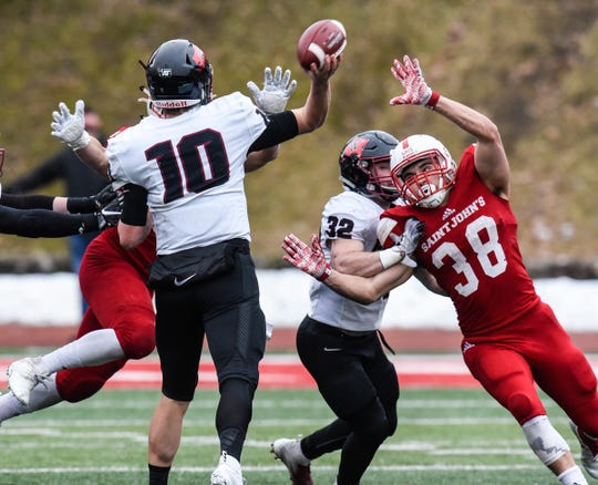 Linebacker Alex Sais of St. John's rushes the quarterback during the Saturday, Nov. 24, game against Whitworth at Clemens Stadium in Collegeville.