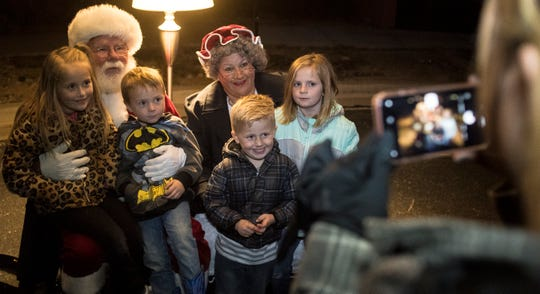 The Oswald family meets Mr. and Mrs. Santa Claus during the opening night of Christmas Lane in Cedar City Friday, November 23, 2018. The lights will be on every night through New Year's Eve, and can be seen all along the Canyon Ridge neighborhood.
