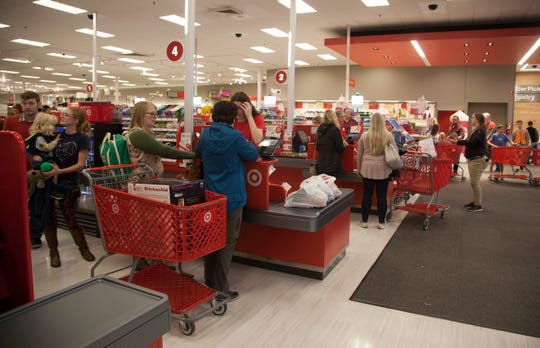 Black Friday shoppers file through the St. George Target Friday, Nov. 23, 2018.