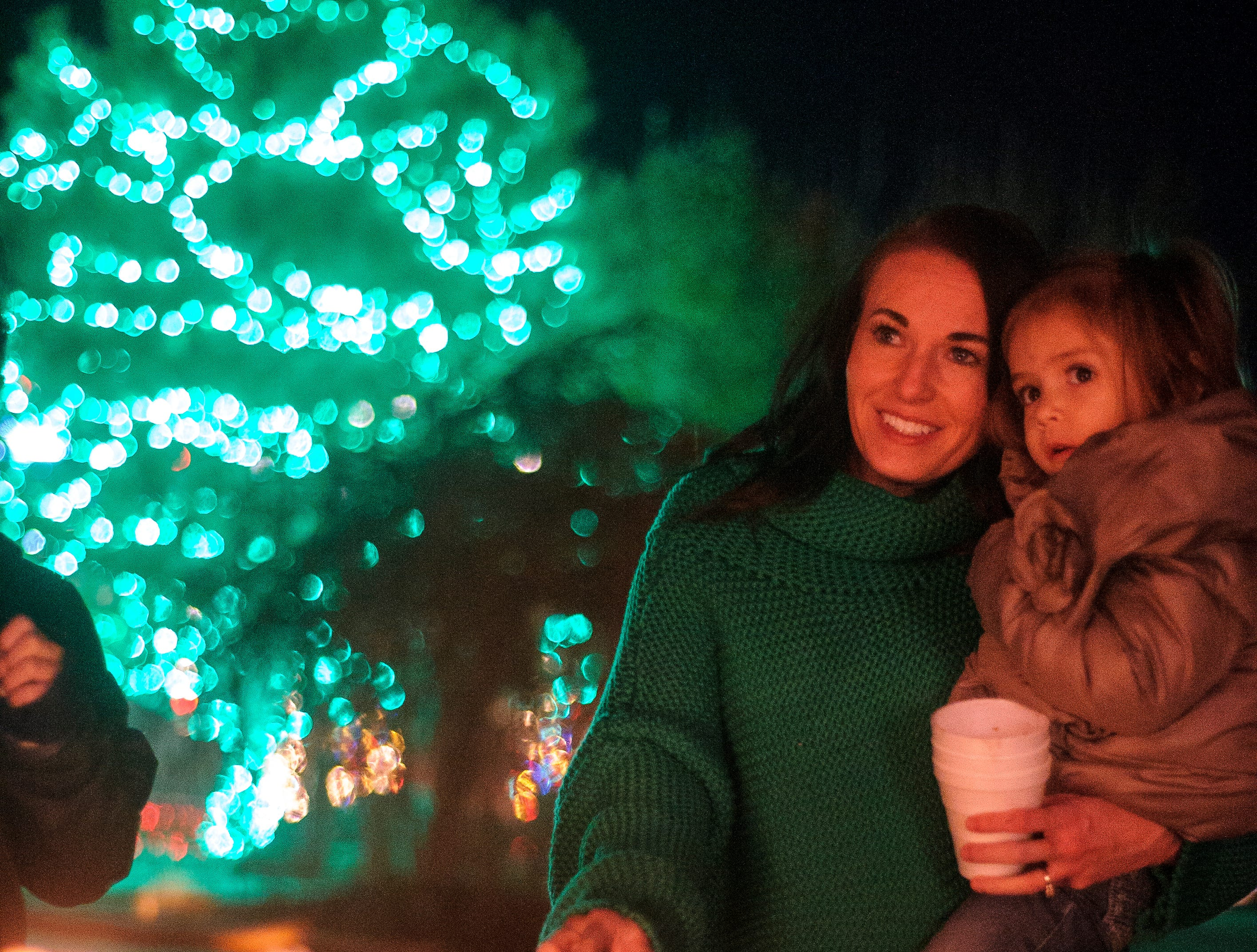 Amy Gilbert, left, and Ivy Miller, right, roast marshmellows during the opening night of Christmas Lane in Cedar City Friday, November 23, 2018. The lights will be on every night through New Year's Eve, and can be seen all along the Canyon Ridge neighborhood.