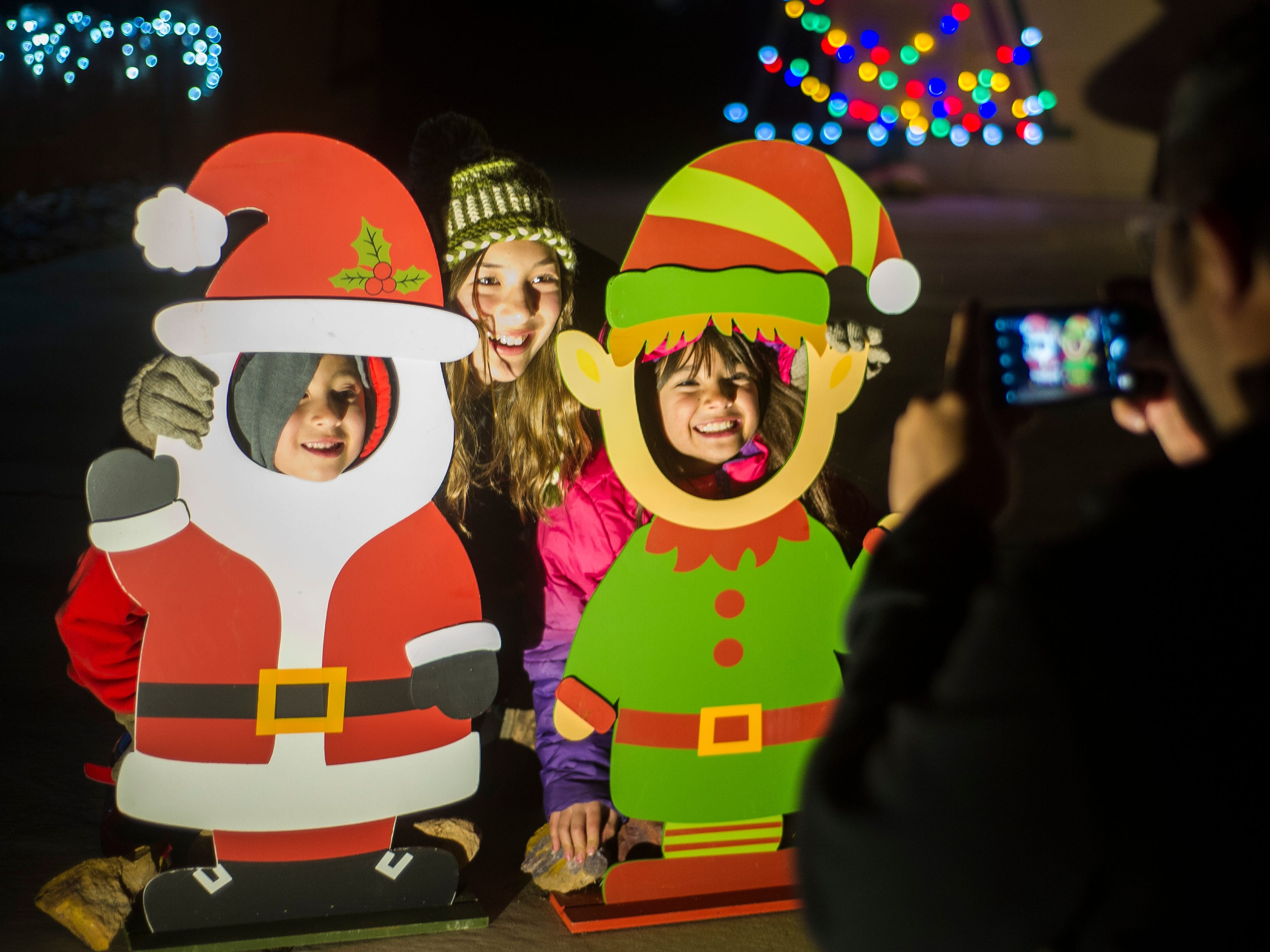 Children take a picture as elves during the opening night of Christmas Lane in Cedar City Friday, November 23, 2018. The lights will be on every night through New Year's Eve, and can be seen all along the Canyon Ridge neighborhood.