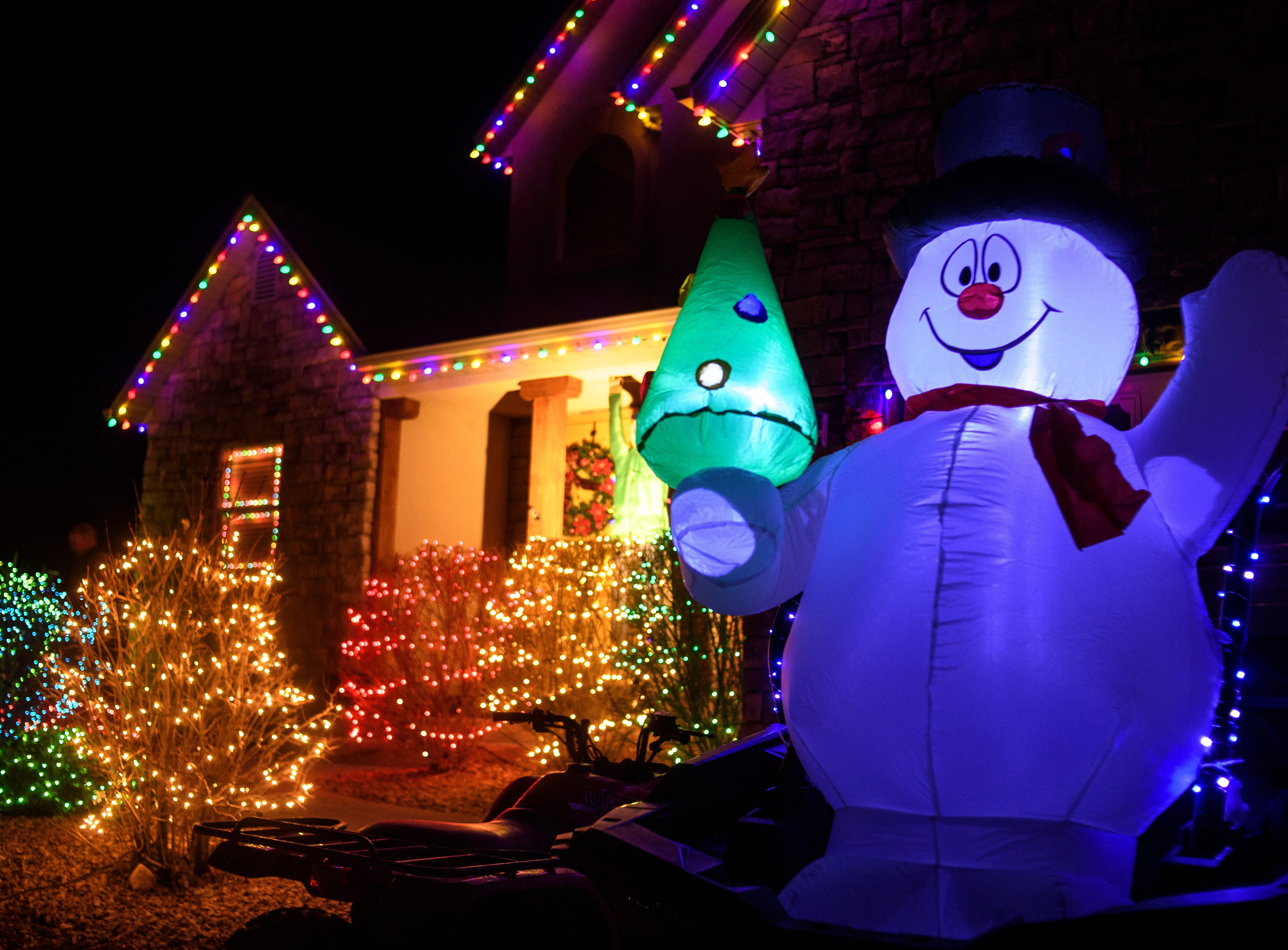 Visitors gather to view Christmas lights during the opening night of Christmas Lane in Cedar City Friday, November 23, 2018. The lights will be on every night through New Year's Eve, and can be seen all along the Canyon Ridge neighborhood.