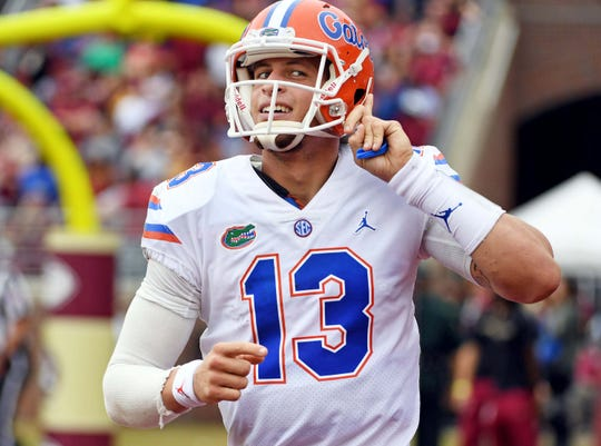 Nov 24, 2018; Tallahassee, FL, USA; Florida Gators quarterback Feleipe Franks (13) makes a gesture to the crowd after the Gators scored their first touchdown during the first half against the Florida State Seminoles at Doak Campbell Stadium. Mandatory Credit: Melina Myers-USA TODAY Sports