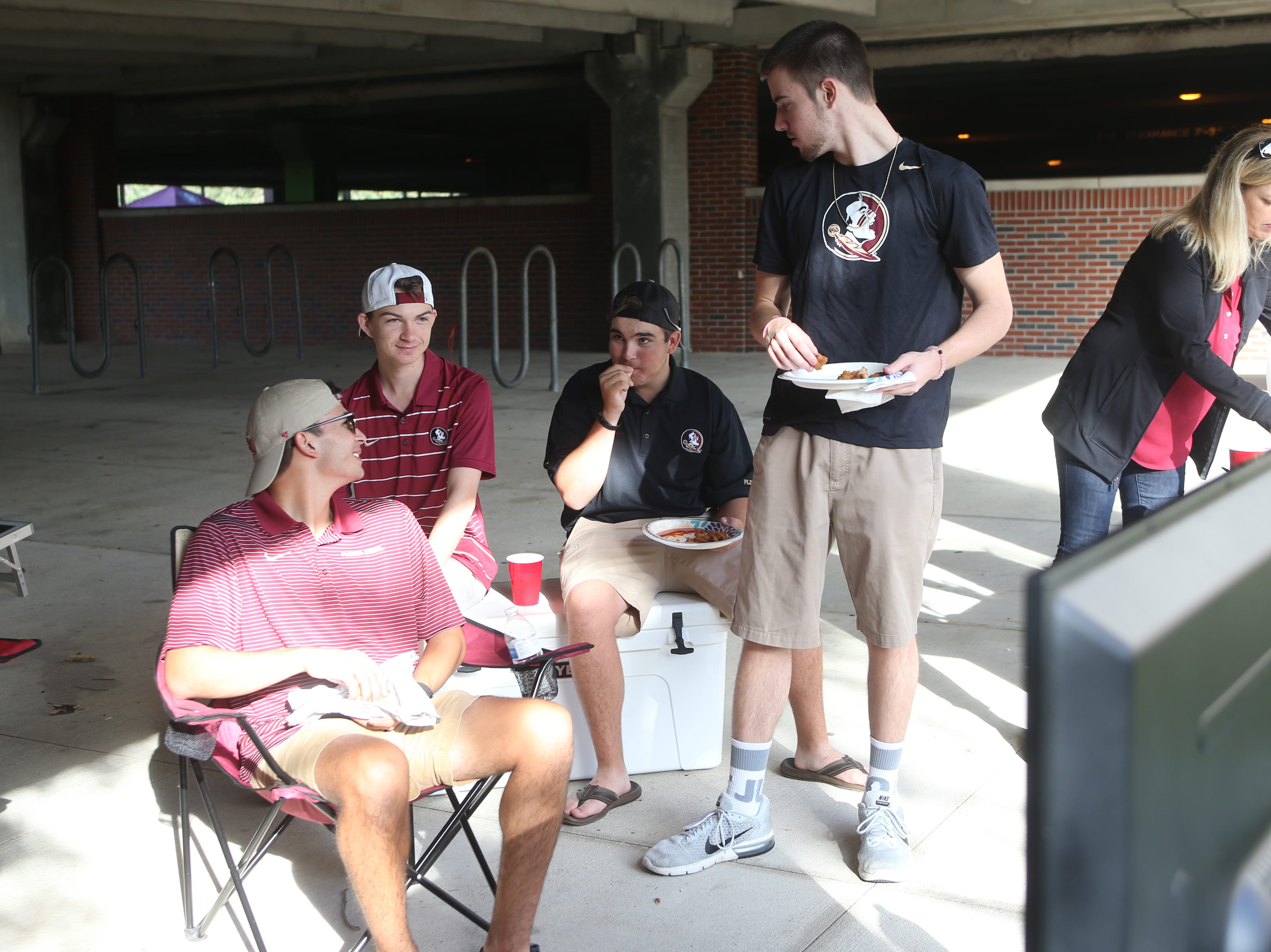 Seminole fans setup a television outside a parking garage as they tailgate before the big rivalry game between the Florida State Seminoles and the Florida Gators, Saturday, Nov. 24, 2018.