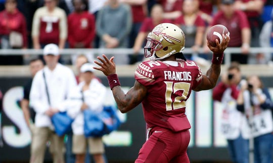 Nov 24, 2018; Tallahassee, FL, USA; Florida State Seminoles quarterback Deondre Francois (12) looks to pass in the first half against the Florida Gators at Doak Campbell Stadium. Mandatory Credit: Glenn Beil-USA TODAY Sports