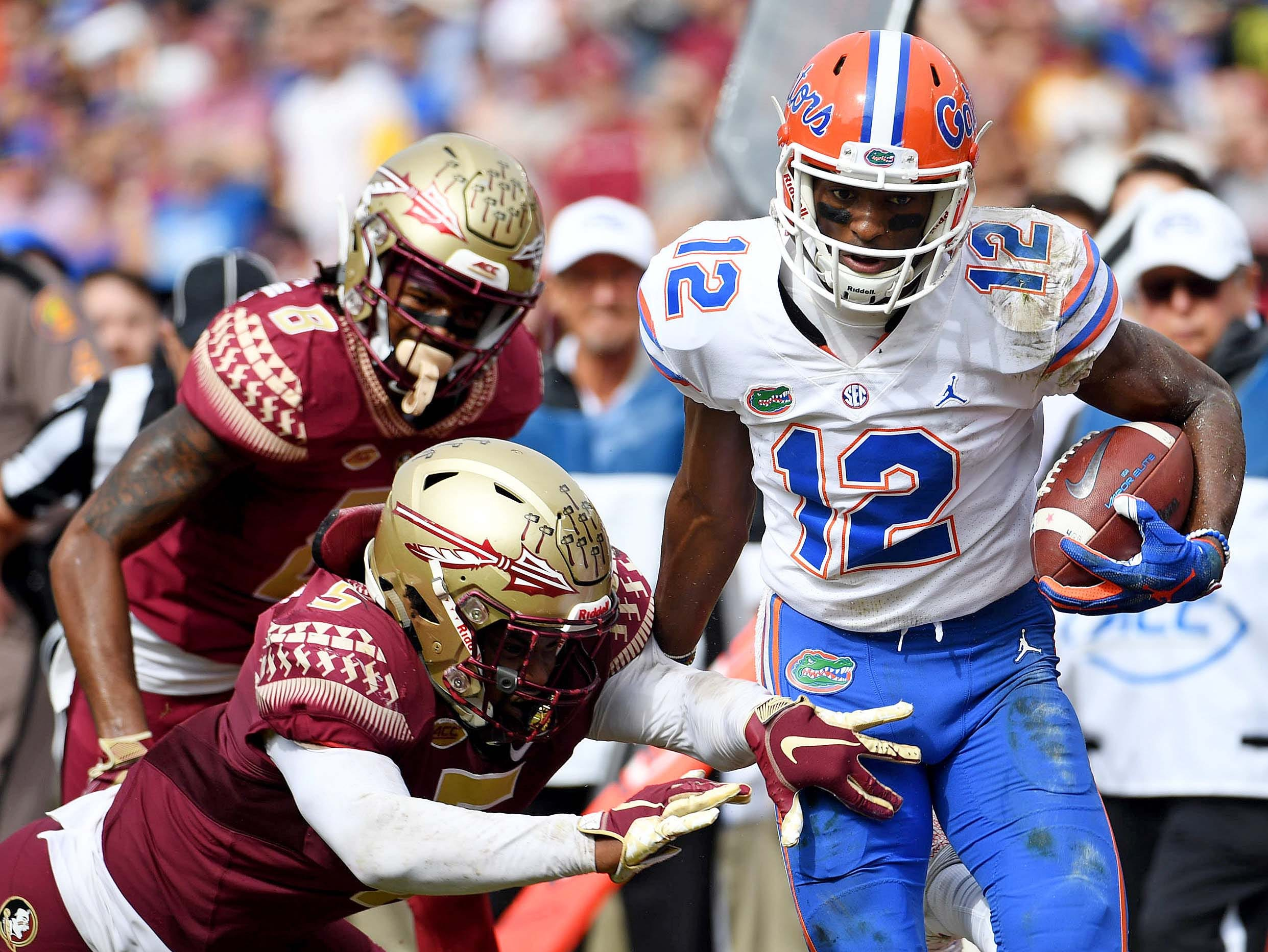 Nov 24, 2018; Tallahassee, FL, USA; Florida Gators wide receiver Van Jefferson (12) is pushed out of bounds by Florida State Seminoles linebacker Dontavious Jackson (5) during the first half at Doak Campbell Stadium. Mandatory Credit: Melina Myers-USA TODAY Sports