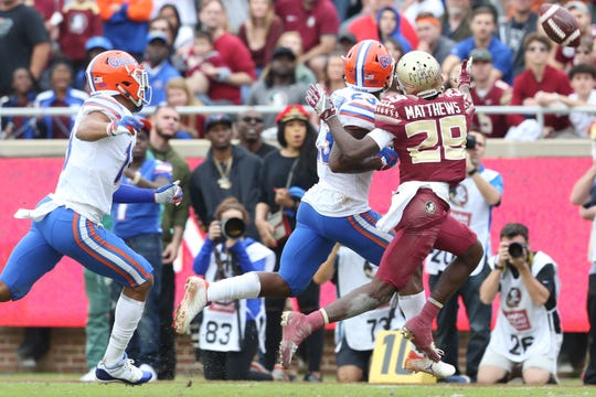 Florida State Seminoles wide receiver D.J. Matthews (29) misses a pass as the Florida State Seminoles take on their rival the Florida Gators in college football at Doak S. Campbell Stadium, Saturday, Nov. 24, 2018.