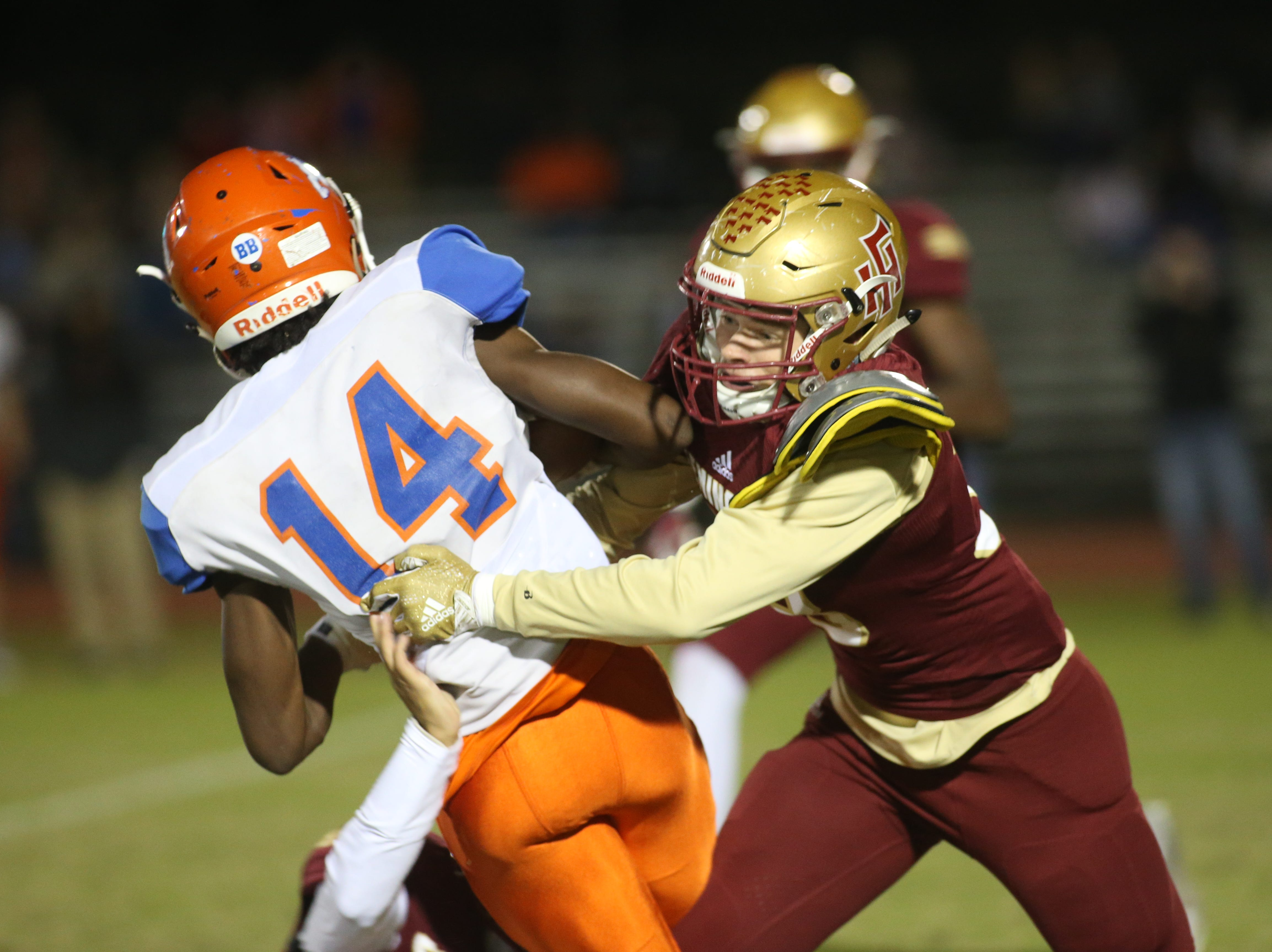 Taylor County Bulldog wide receiver Robert Glanton (14) fights a tackle off as the Taylor County Bulldogs play the Florida High Seminoles in a Region 1-3A final on Friday, Nov. 23, 2018.