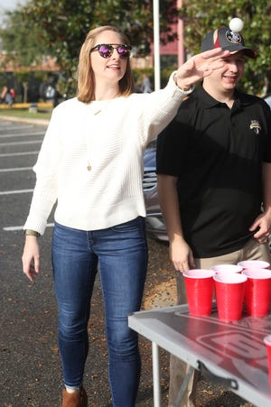 Loreli Smyth plays cup pong with friends as she tailgates before the big rivalry game between the Florida State Seminoles and the Florida Gators, Saturday, Nov. 24, 2018.