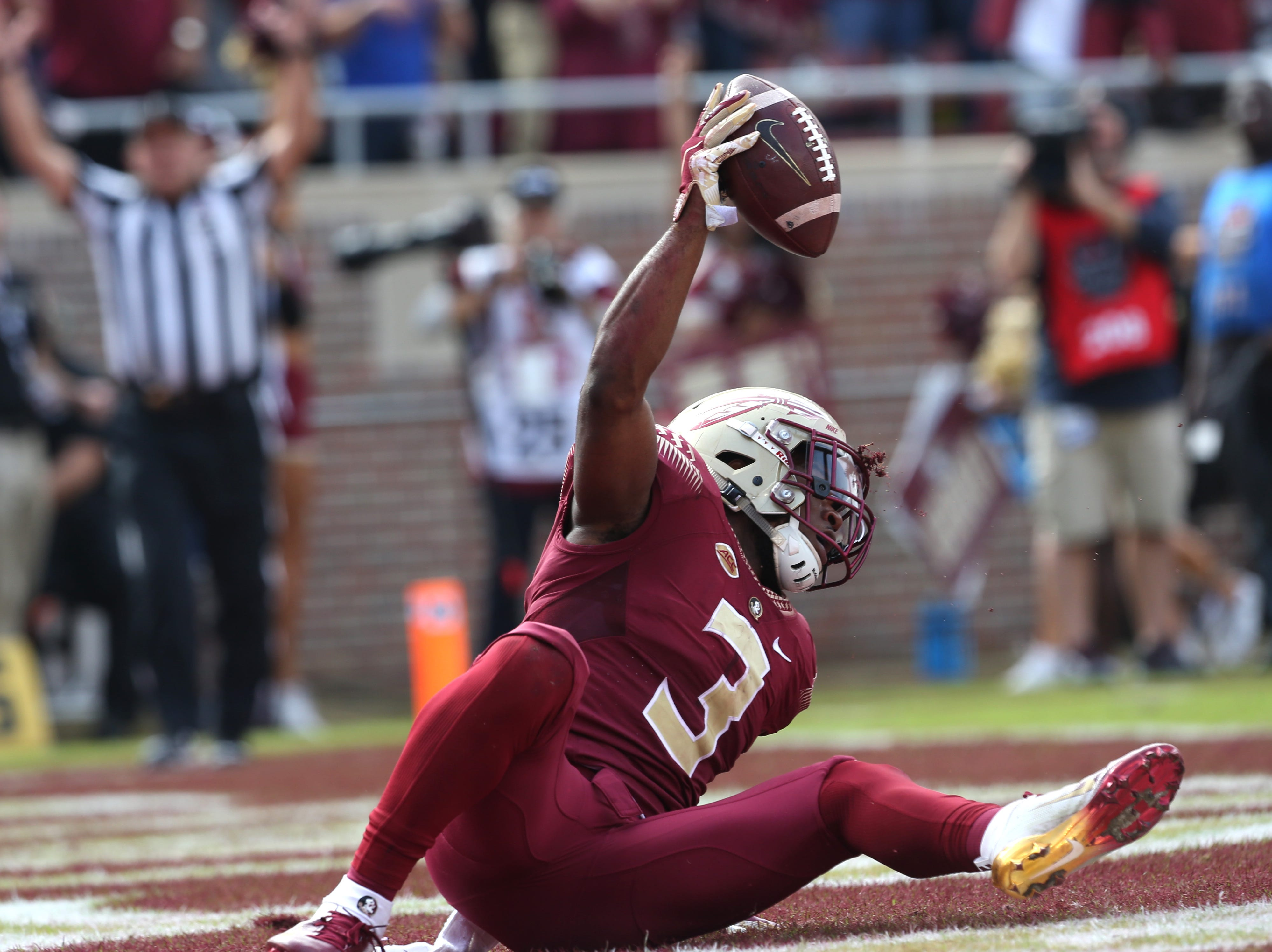 Florida State Seminoles running back Cam Akers (3) stumbles into the end zone for a touchdown as the Florida State Seminoles take on their rival the Florida Gators in college football at Doak S. Campbell Stadium, Saturday, Nov. 24, 2018.