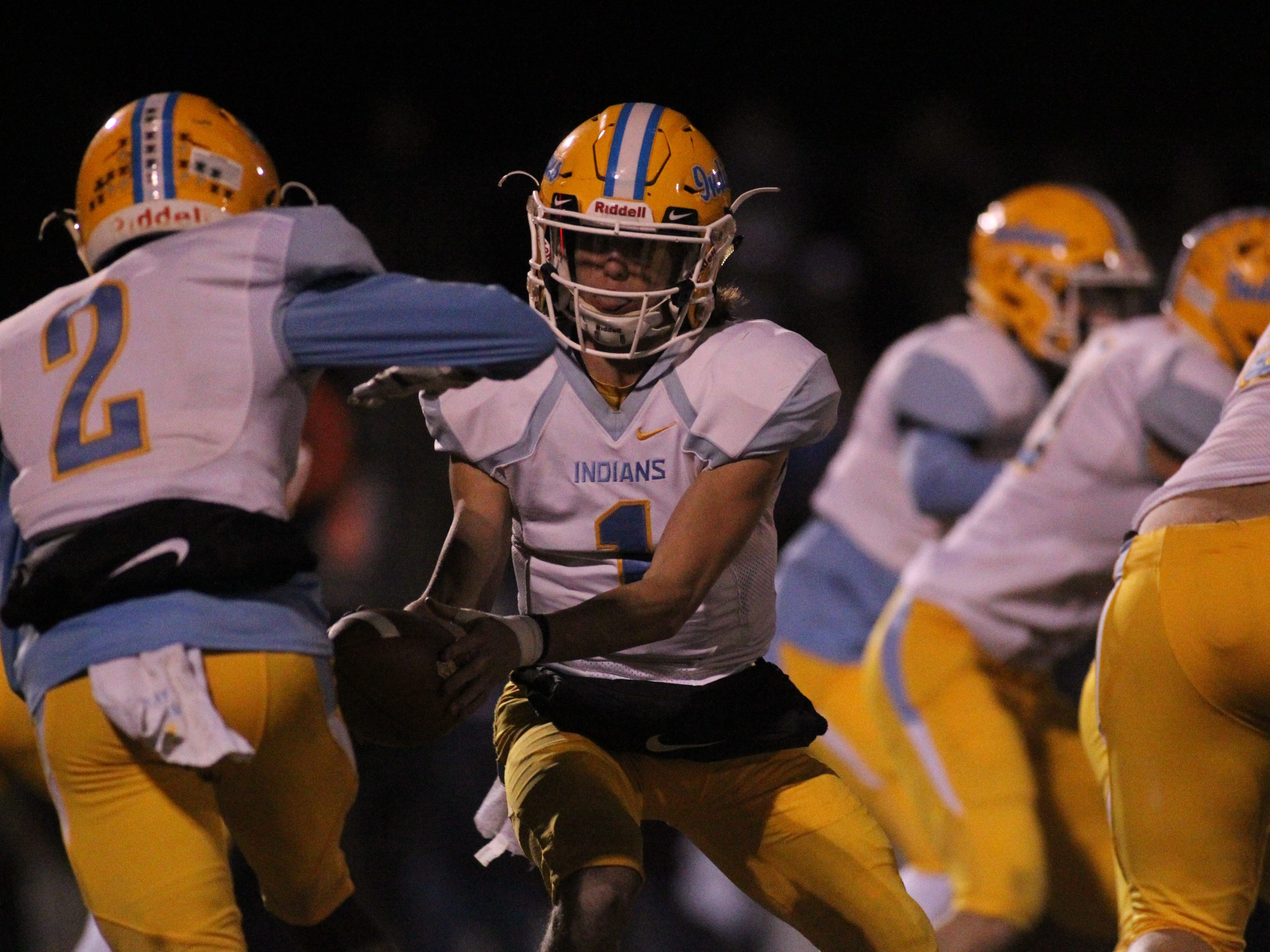 Chiefland quarterback Ty Corbin hands off to Jalen Rutledge on a wing-T option play as Madison County beat Chiefland 49-14 in a Region 3-1A final at Boot Hill Stadium on Friday, Nov. 23, 2018.
