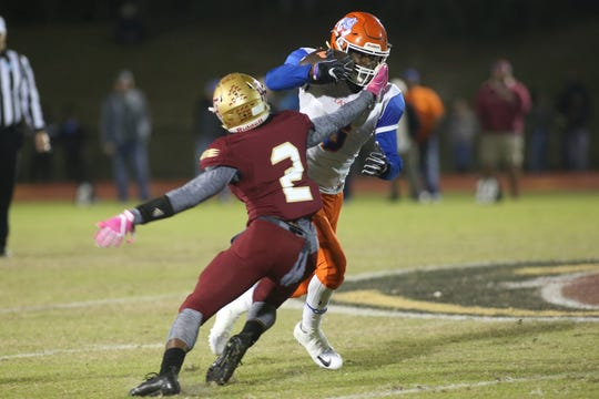 Florida High cornerback Javan Morgan (2) goes to tackle Taylor County wide receiver Zoe Roberts (6) during a Region 1-3A final on Friday, Nov. 23, 2018.