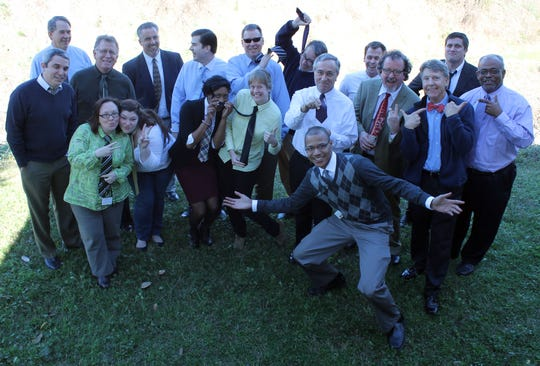 18 members of the Tallahassee Democrat staff observe a self-declared Tie Day including Gerald Ensley, third from right, and Sean Rossman, fifth from left.