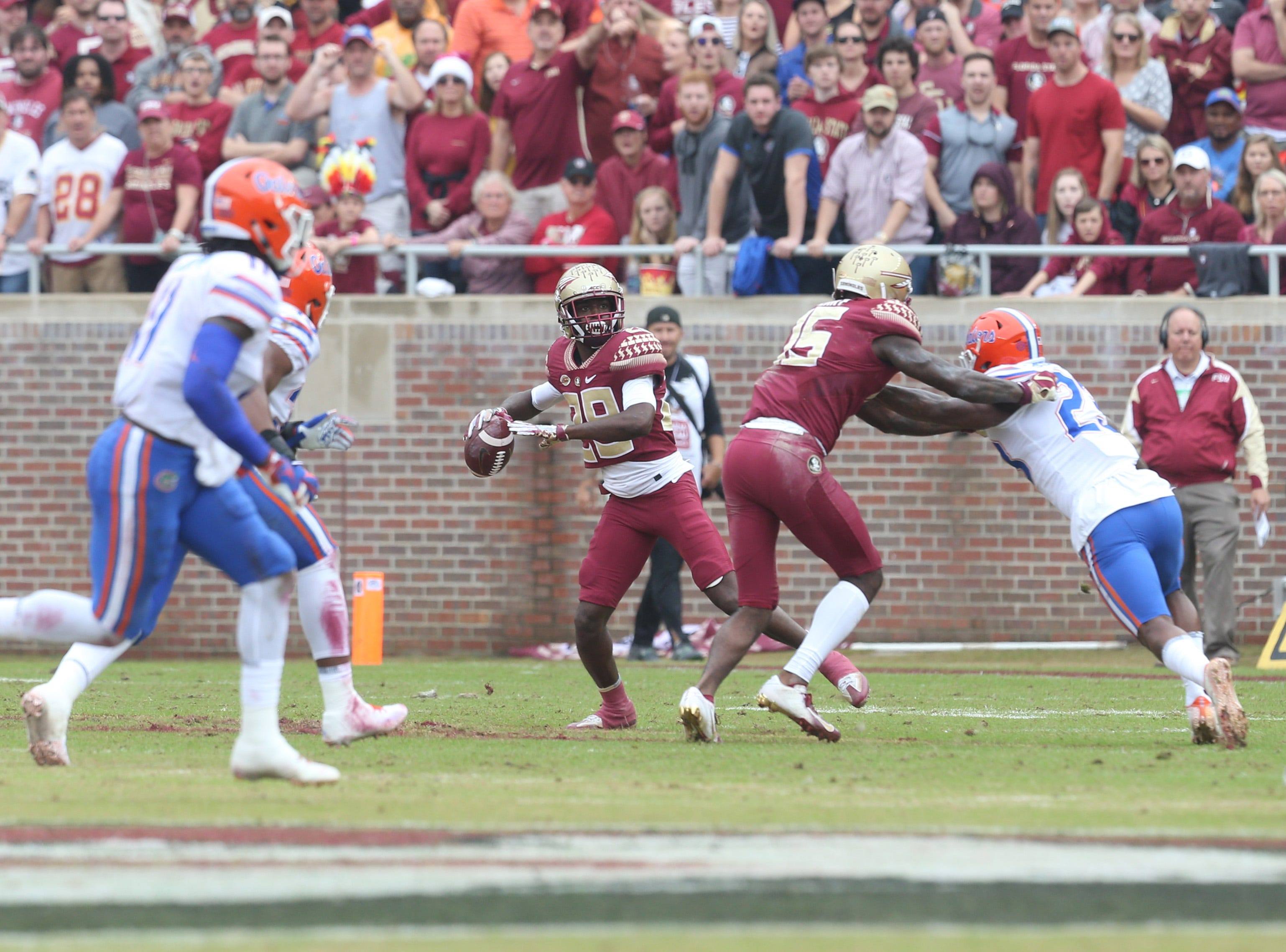 Florida State Seminoles wide receiver D.J. Matthews (29) attempts to pass as the Florida State Seminoles take on their rival the Florida Gators in college football at Doak S. Campbell Stadium, Saturday, Nov. 24, 2018.