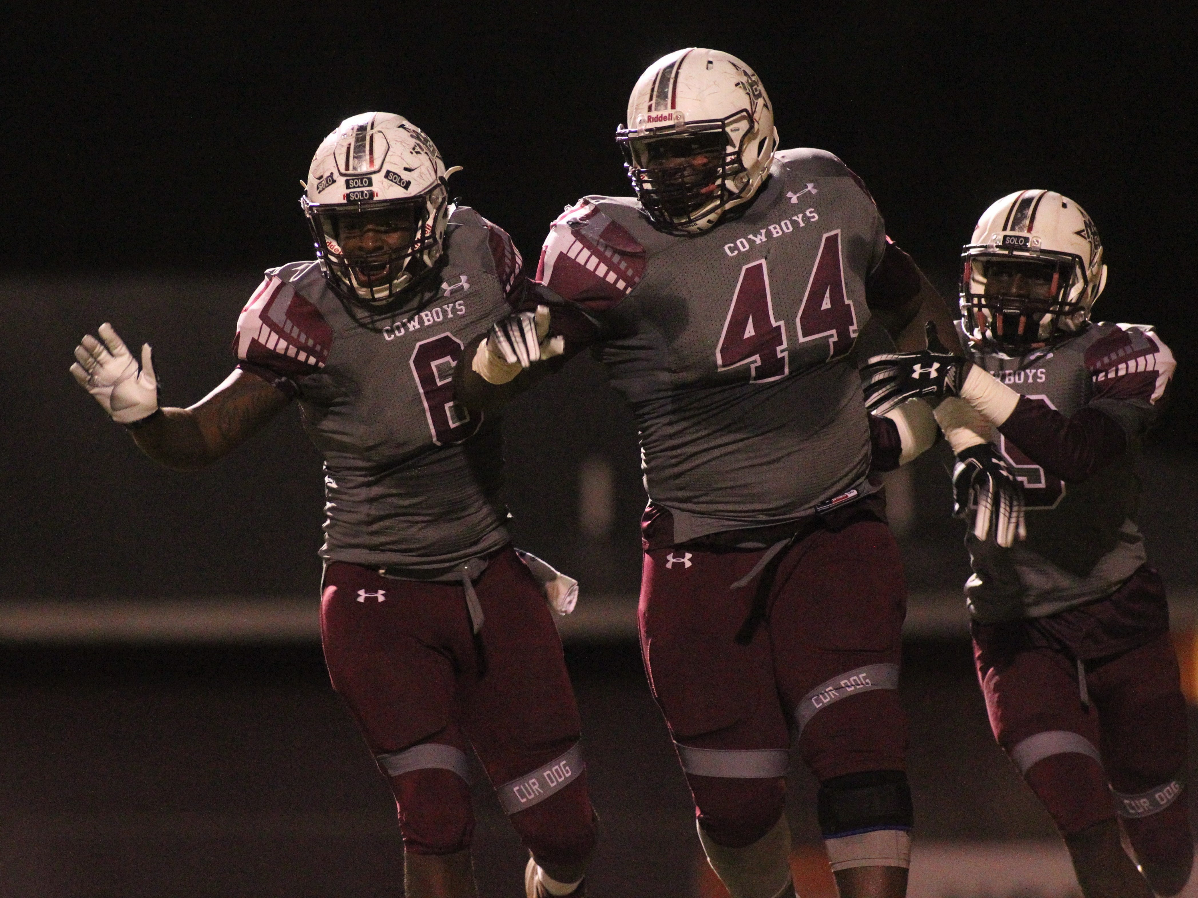 Patrick Hampton (6), Terray Jones (44) and Derrion Staten (9) celebrate Hampton's punt block and Jones' return touchdown as Madison County beat Chiefland 49-14 in a Region 3-1A final at Boot Hill Stadium on Friday, Nov. 23, 2018.