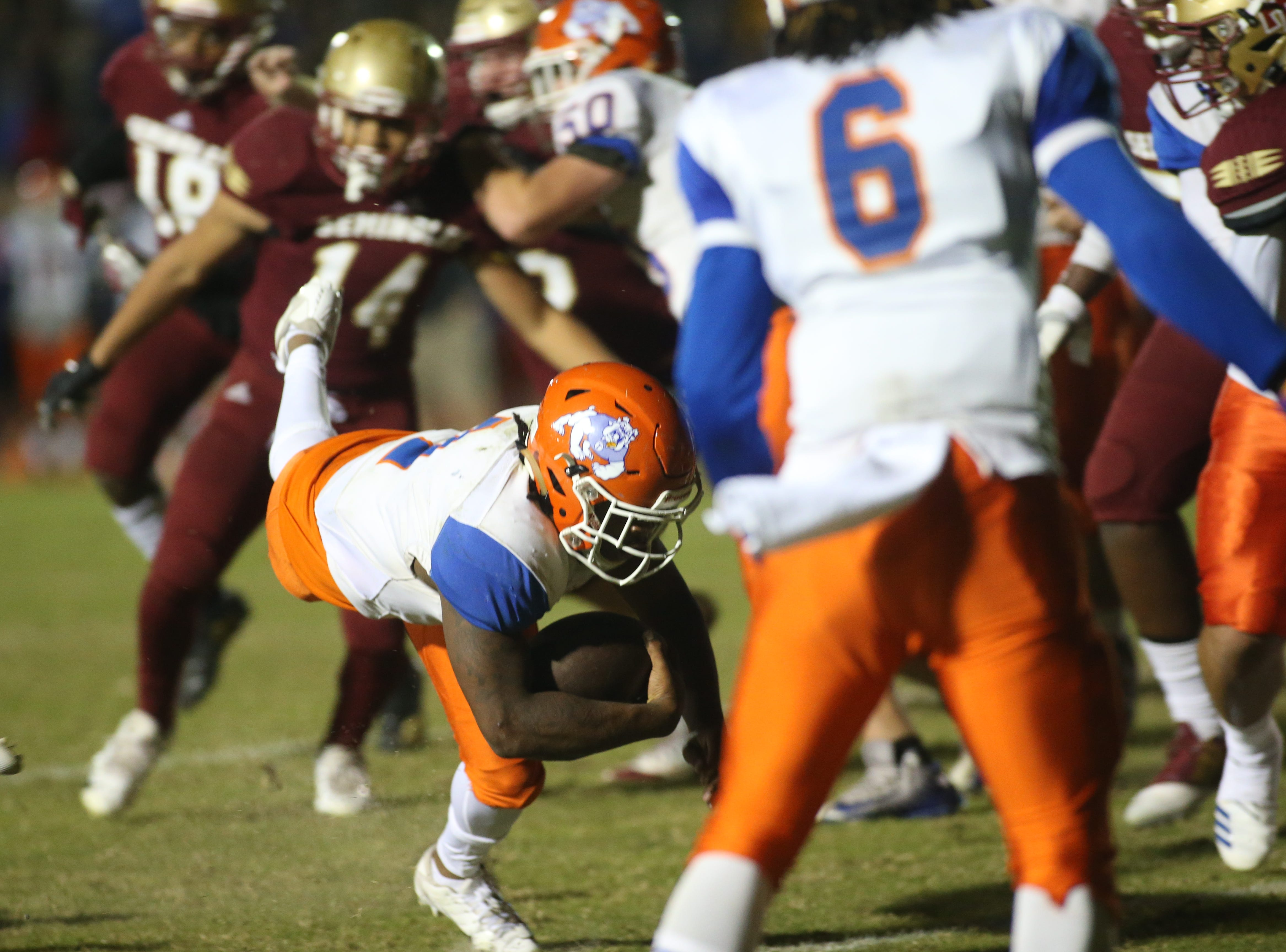 Taylor County Bulldog quarterback Da'corian Bellamy (1) stumbles in for a touchdown as the Taylor County Bulldogs play the Florida High Seminoles in a Region 1-3A final on Friday, Nov. 23, 2018.