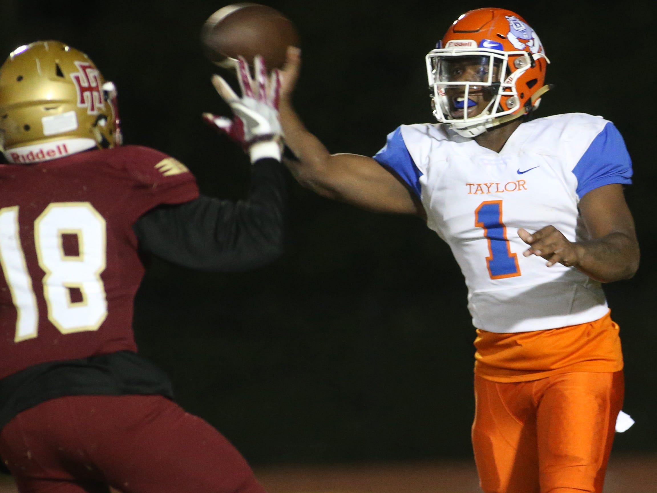 Taylor County Bulldog quarterback Da'corian Bellamy (1) passes as the Taylor County Bulldogs play the Florida High Seminoles in a Region 1-3A final on Friday, Nov. 23, 2018.