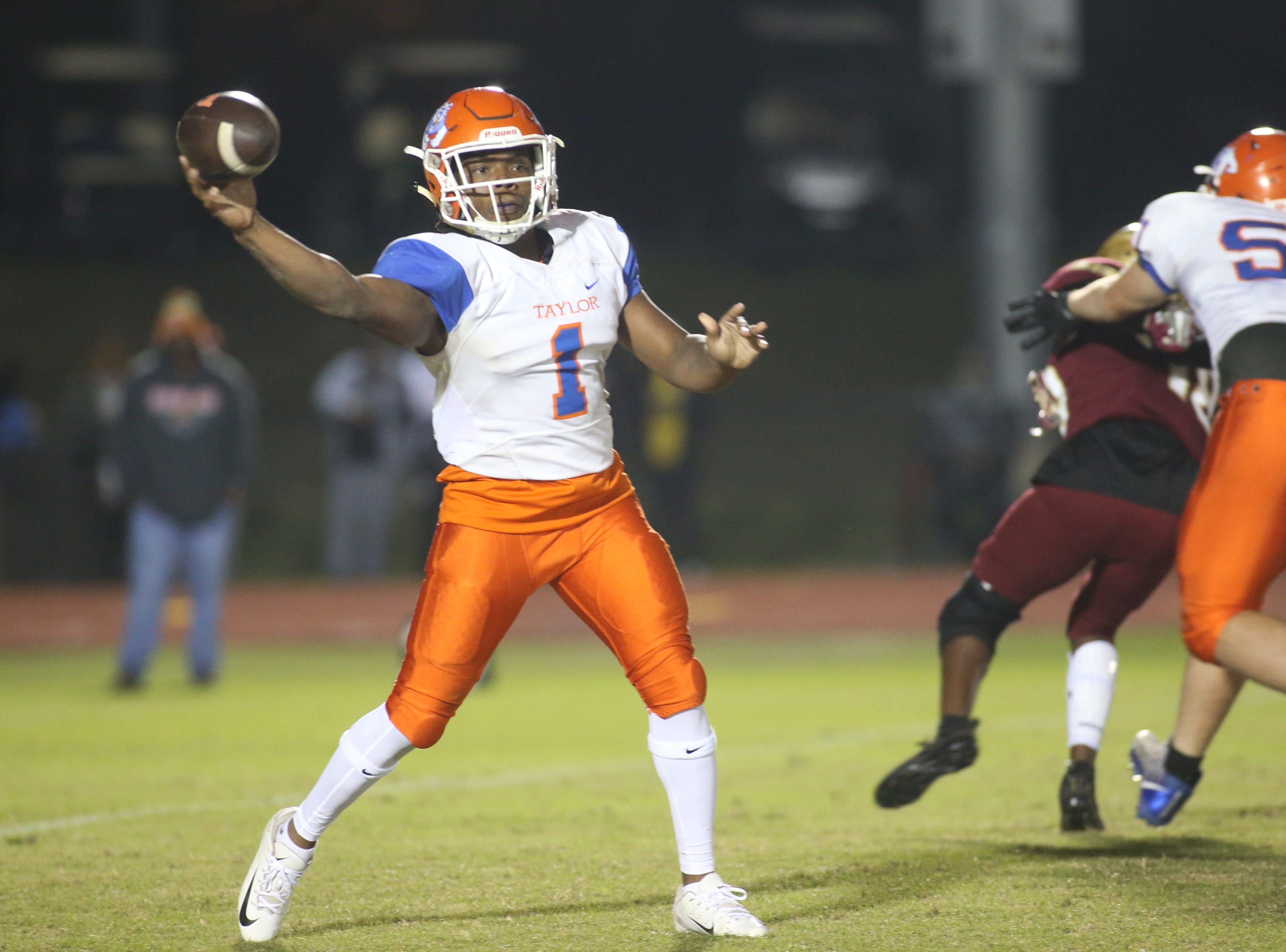 Taylor County Bulldog quarterback Da'corian Bellamy (1) passes to a teammate as the Taylor County Bulldogs play the Florida High Seminoles in a Region 1-3A final on Friday, Nov. 23, 2018.