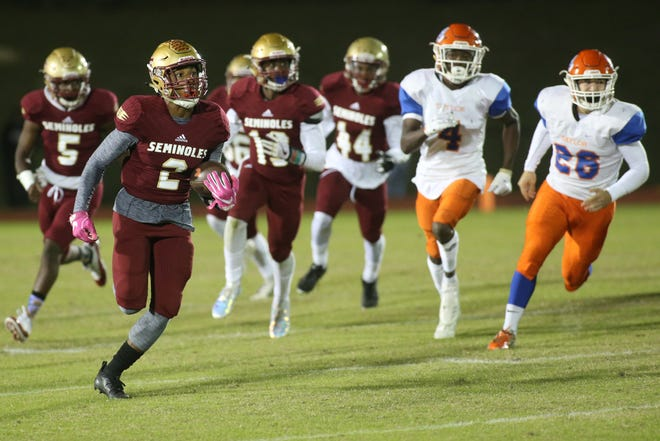 Florida High's Javan Morgan (2) returns a punt for a touchdown as the Seminoles beat Taylor County 30-22 in a Region 1-3A final on Friday, Nov. 23, 2018.