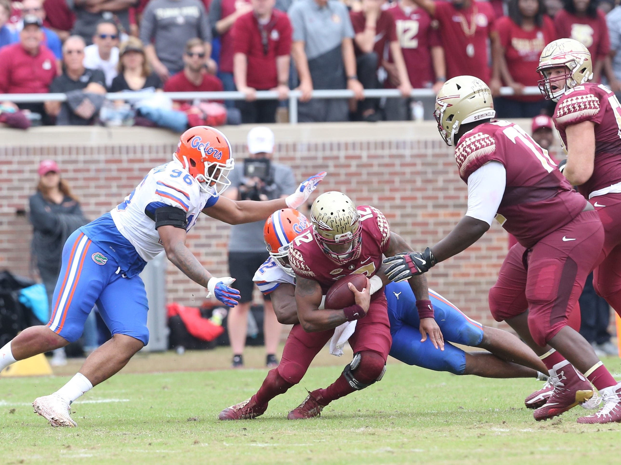 Florida State Seminoles quarterback Deondre Francois (12) gets tackled as the Florida State Seminoles take on their rival the Florida Gators in college football at Doak S. Campbell Stadium, Saturday, Nov. 24, 2018.
