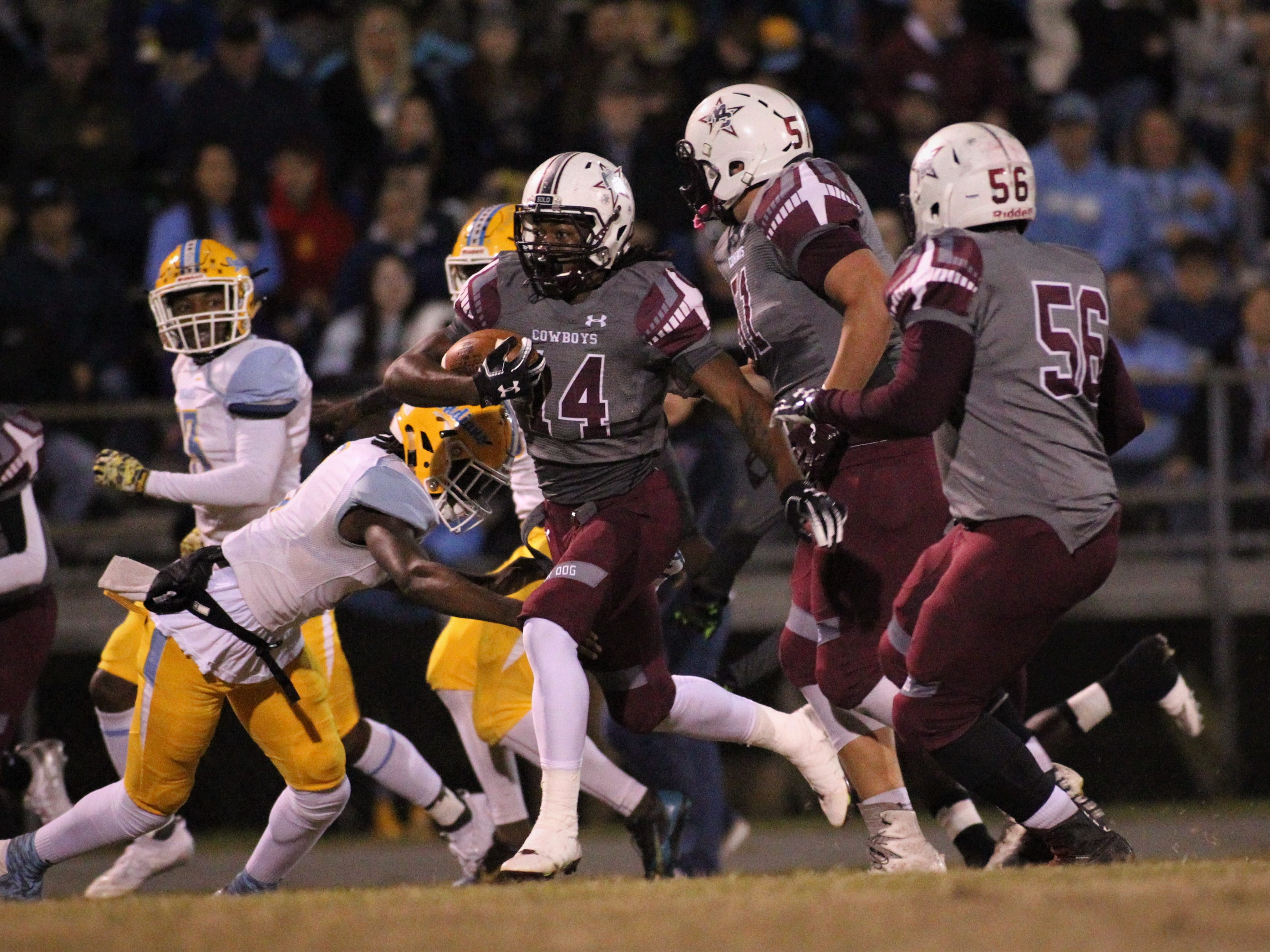 Melvin Brown takes a screen pass for a big gain as Madison County beat Chiefland 49-14 in a Region 3-1A final at Boot Hill Stadium on Friday, Nov. 23, 2018.