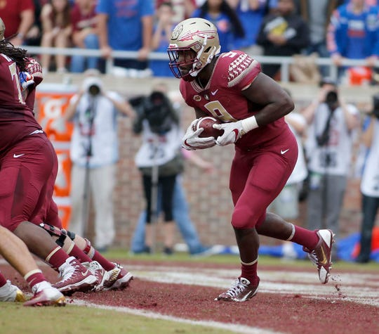 Nov 24, 2018; Tallahassee, FL, USA; Florida State Seminoles running back Jacques Patrick (9) looks for running room from his own end zone abasing the Florida Gators during the first half of action at Doak Campbell Stadium. Mandatory Credit: Glenn Beil-USA TODAY Sports