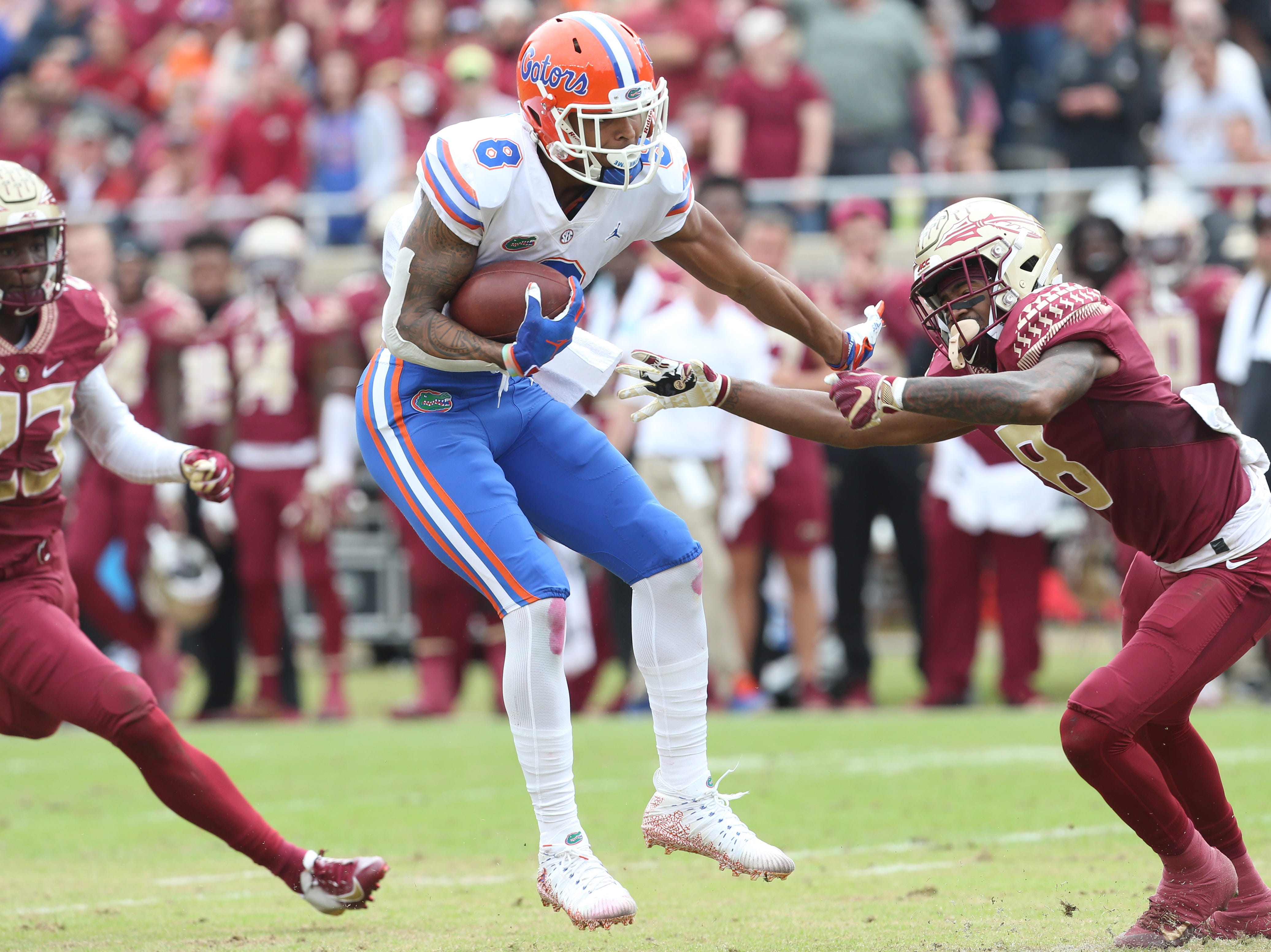 Florida Gators wide receiver Trevon Grimes (8) tries to dodge Florida State Seminoles defensive back Stanford Samuels III (8) as the Florida State Seminoles take on their rival the Florida Gators in college football at Doak S. Campbell Stadium, Saturday, Nov. 24, 2018.